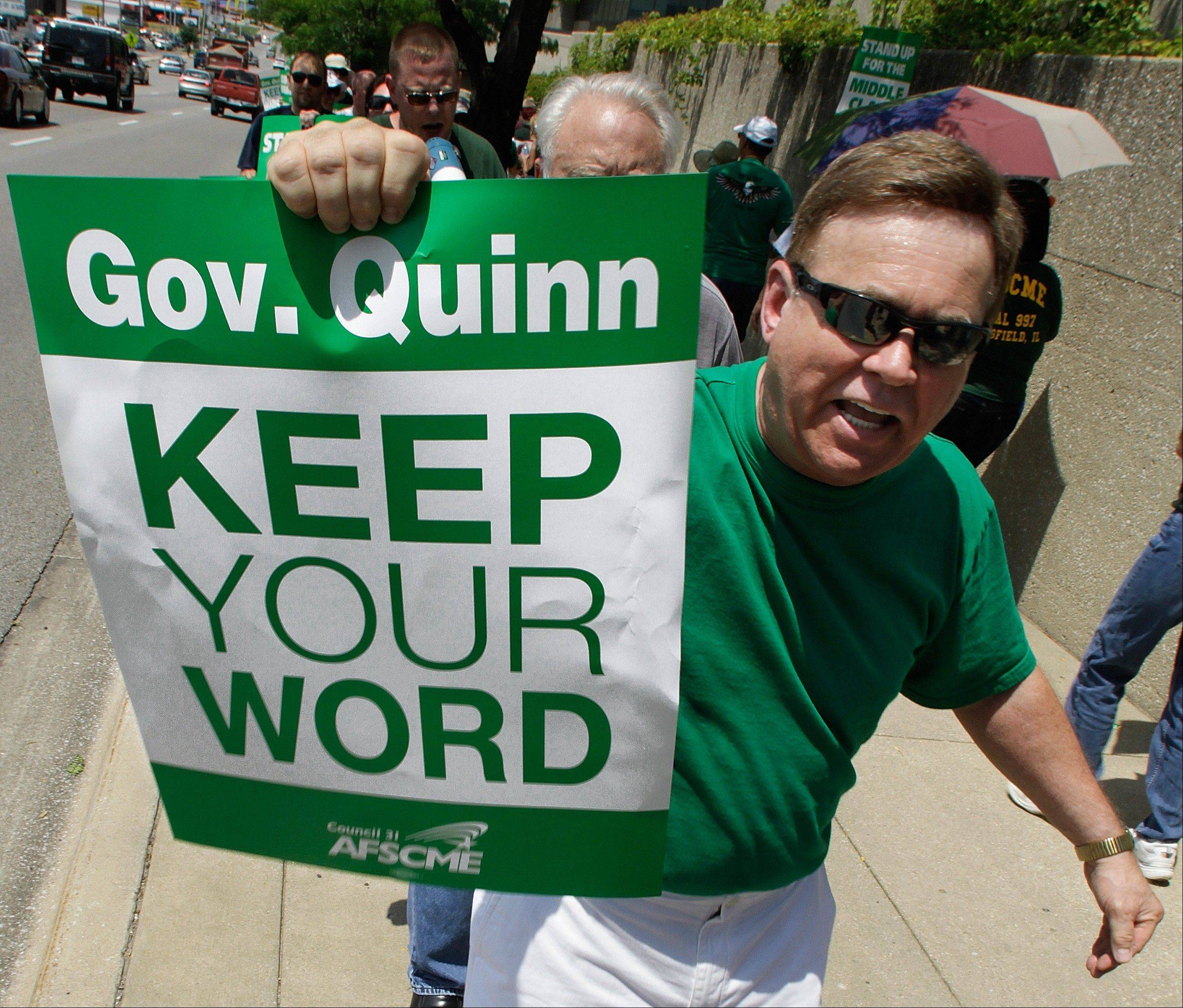 American Federation of State, County and Municipal Employees, AFSCME, walk an informational picket line July 12 in Springfield to protest Quinn�s decision not to pay their contractual raises.