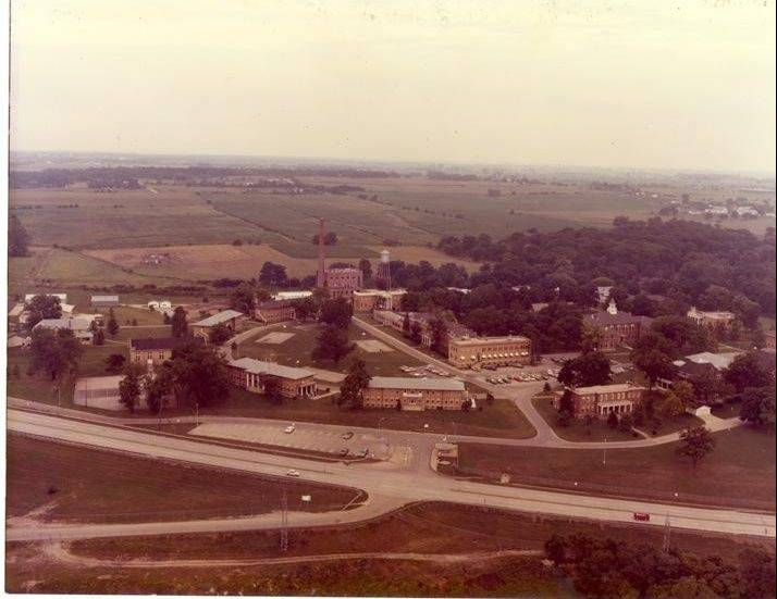 An aerial view (circa 1970s) of the Girl's School buildings and grounds formerly located on Route 25 in Geneva, south of the railroad tracks. The Fox Run subdivision is located there today.