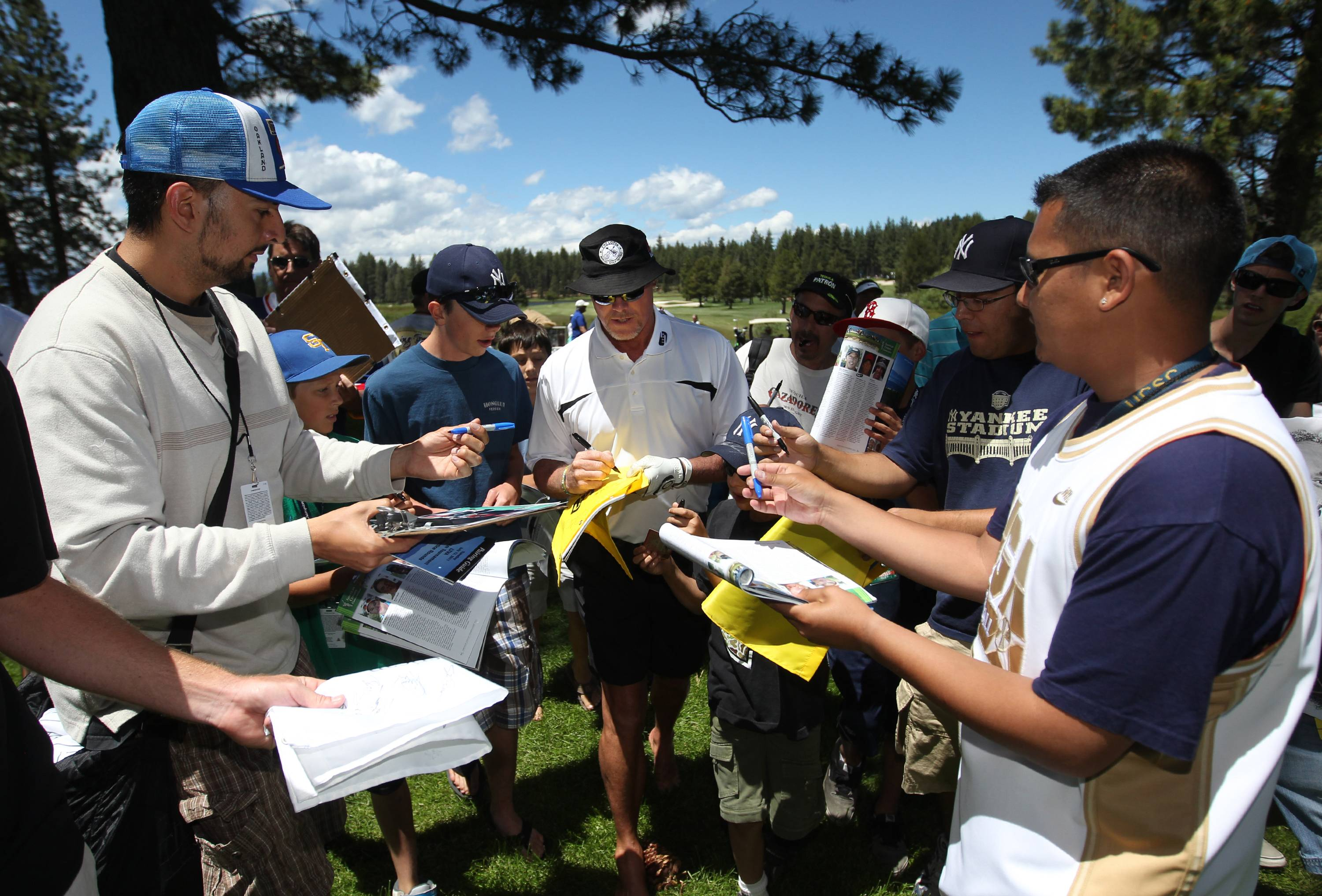 Jim McMahan signs autographs during the 22nd American Century Celebrity Golf Championship at Edgewood Tahoe Golf Course in Stateline, Nev., on Wednesday. McMahon was taken to a Reno hospital Monday after the limousine he was riding in crashed through a fence. Authorities said no one was seriously injured in the accident.