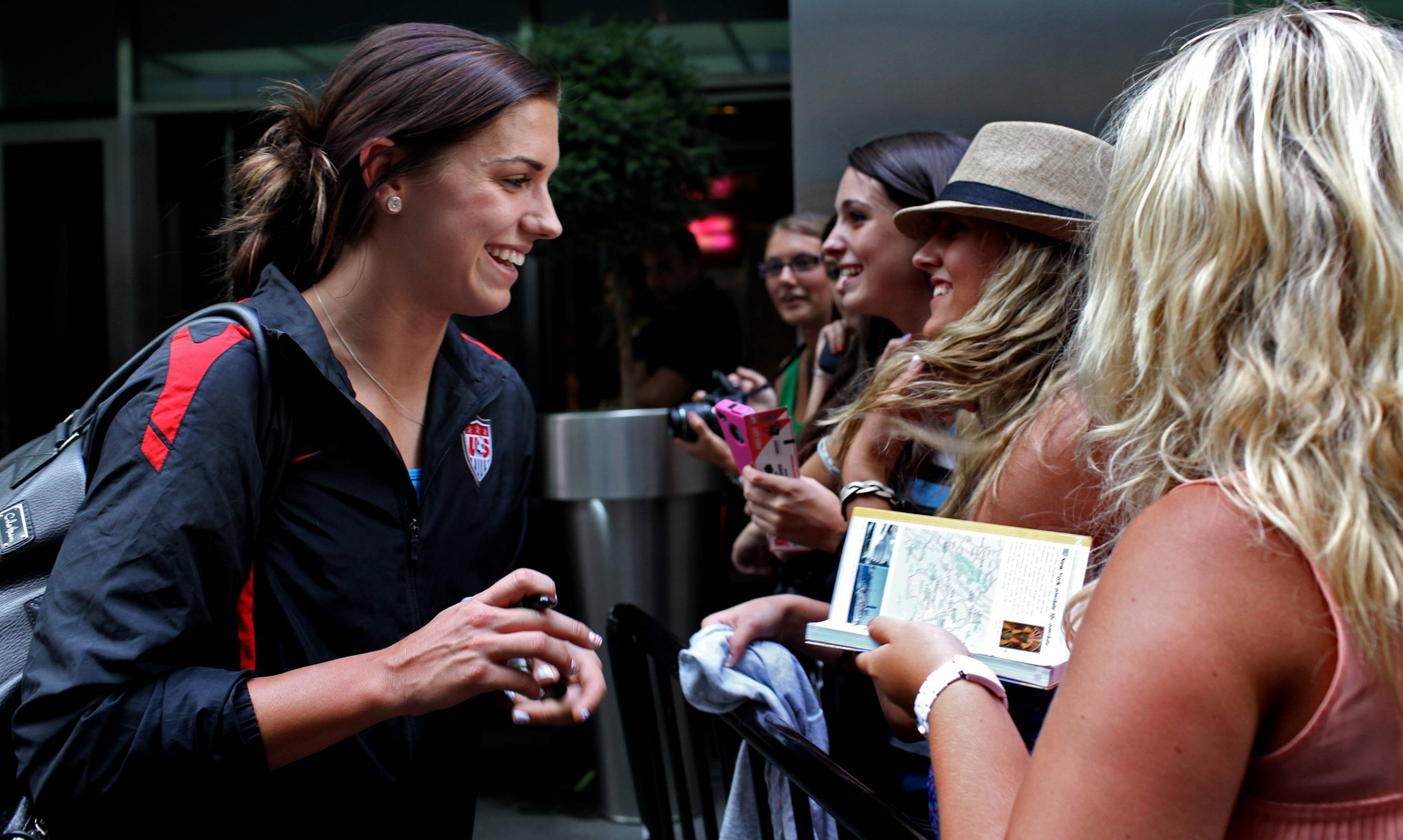 Alex Morgan greets fans Monday after she and other members of the U.S. soccer team arrived in New York's Times Square.