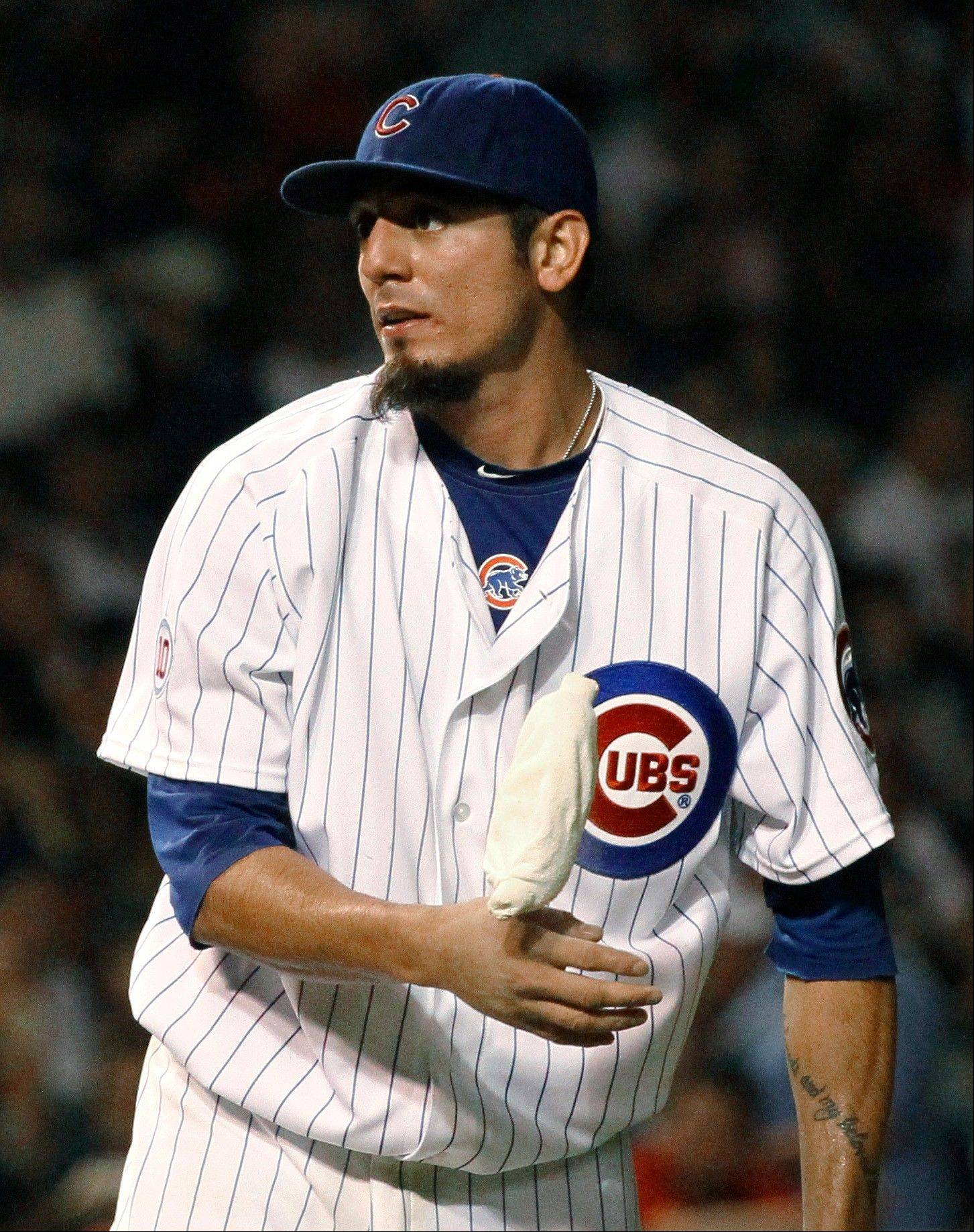 Chicago Cubs starting pitcher Matt Garza uses the rosin bag during the seventh inning against the Philadelphia Phillies. He was taken out in the eighth.