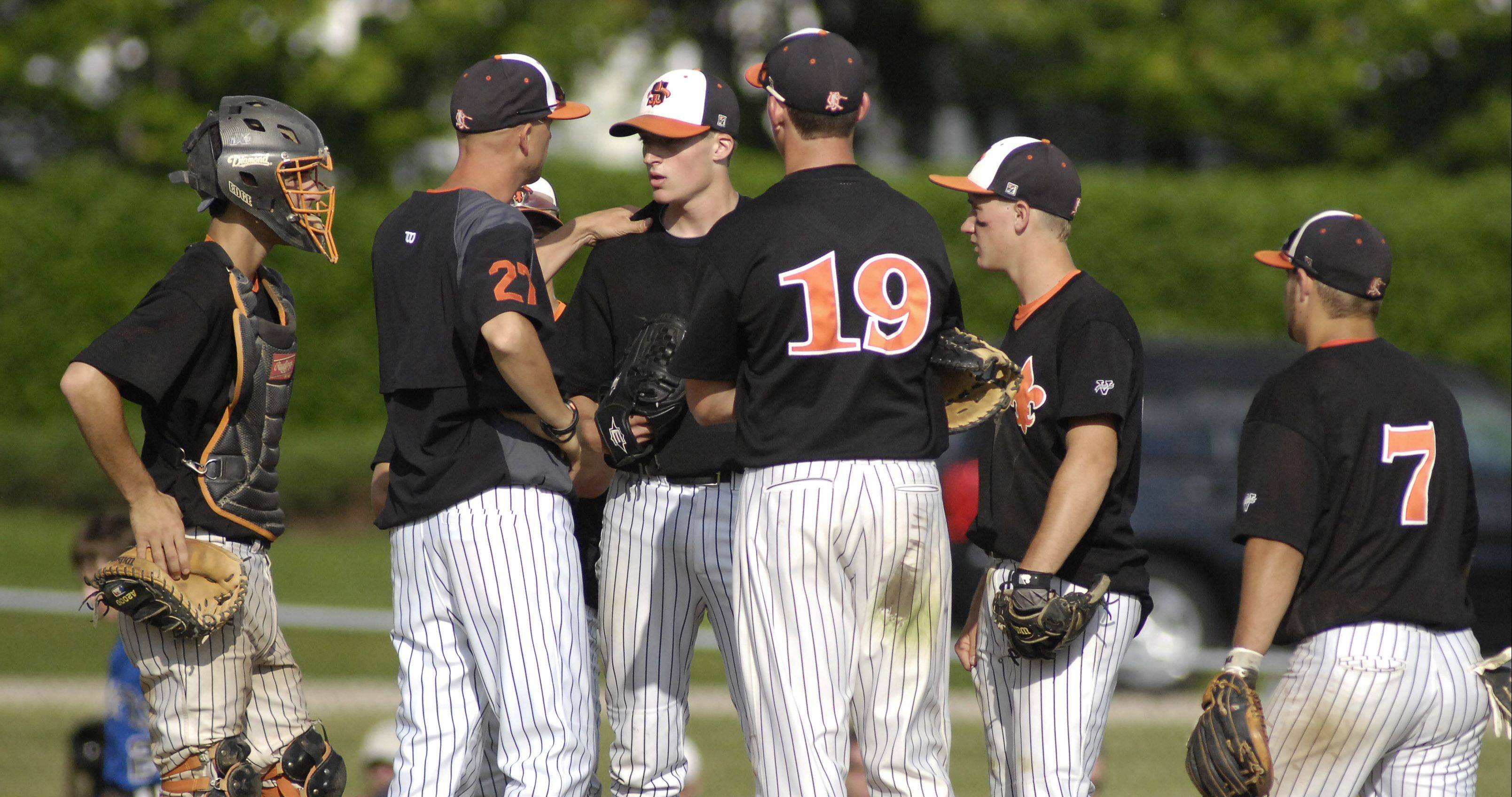 Dave Haskins, pictured talking to former pitcher Wes Benjamin, coached his final game with St. Charles East on Tuesday.