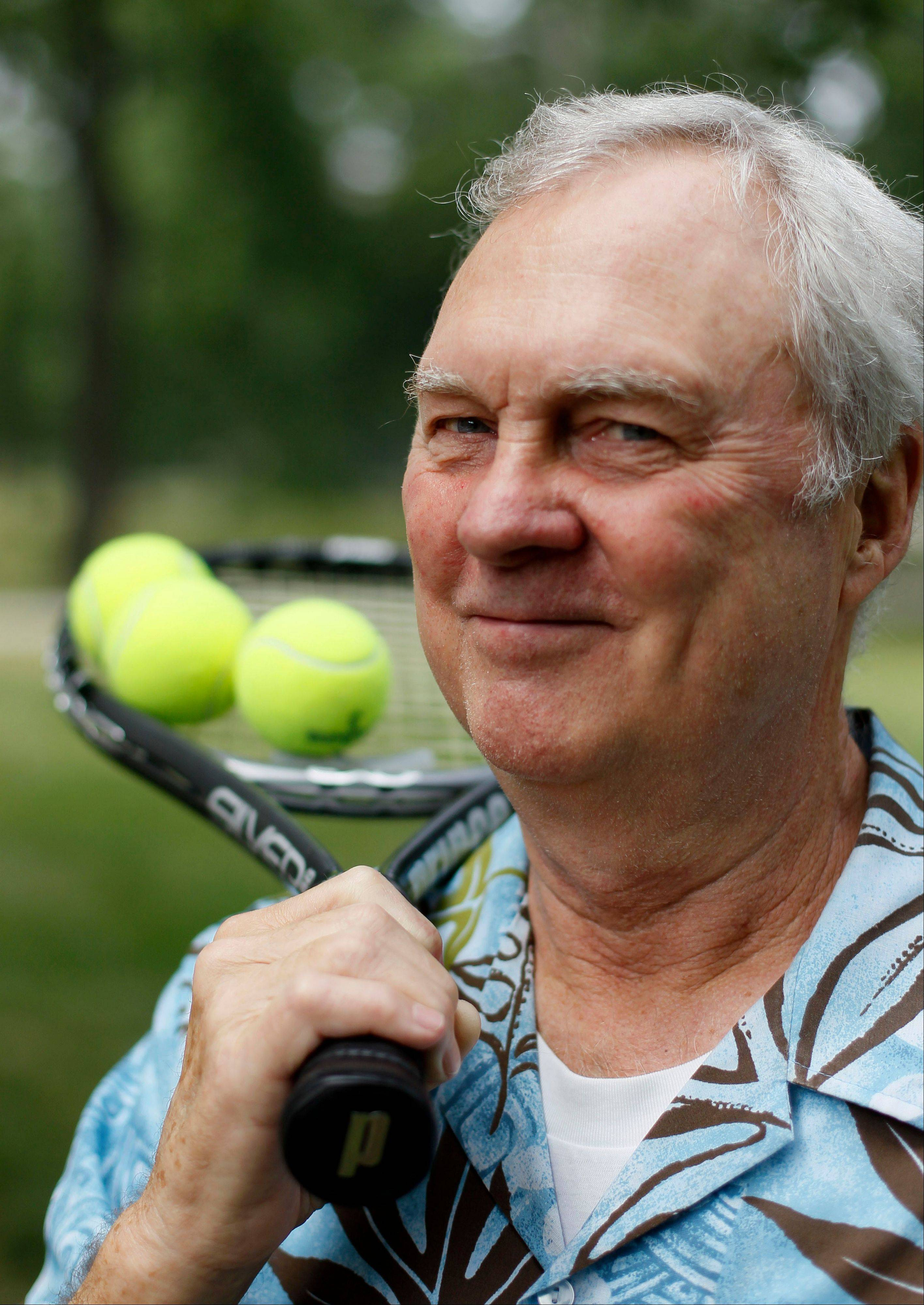 Don Worden, 79, poses with his tennis racket outside his home Tuesday in Chicago. Healthy, active seniors enduring this week's heat wave without any trouble are reminded that they need more water to keep the blood flowing and are far more at risk of dehydration and heat stroke.