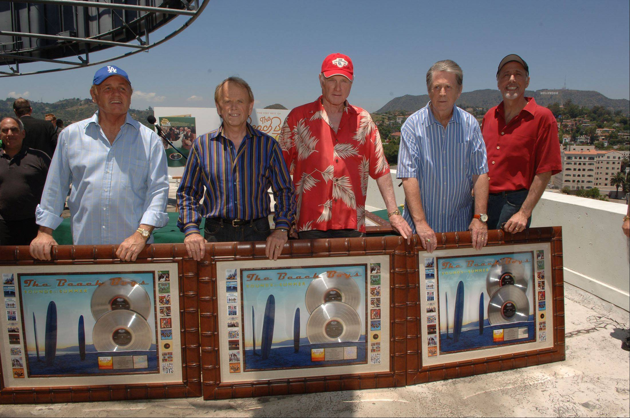 In this photo released by Capitol/EMI, The Beach Boys, from left, Bruce Johnston, Al Jardine, Mike Love, Brian Wilson and David Marks, pose together on the rooftop of Capitol Records in Los Angeles in 2006.