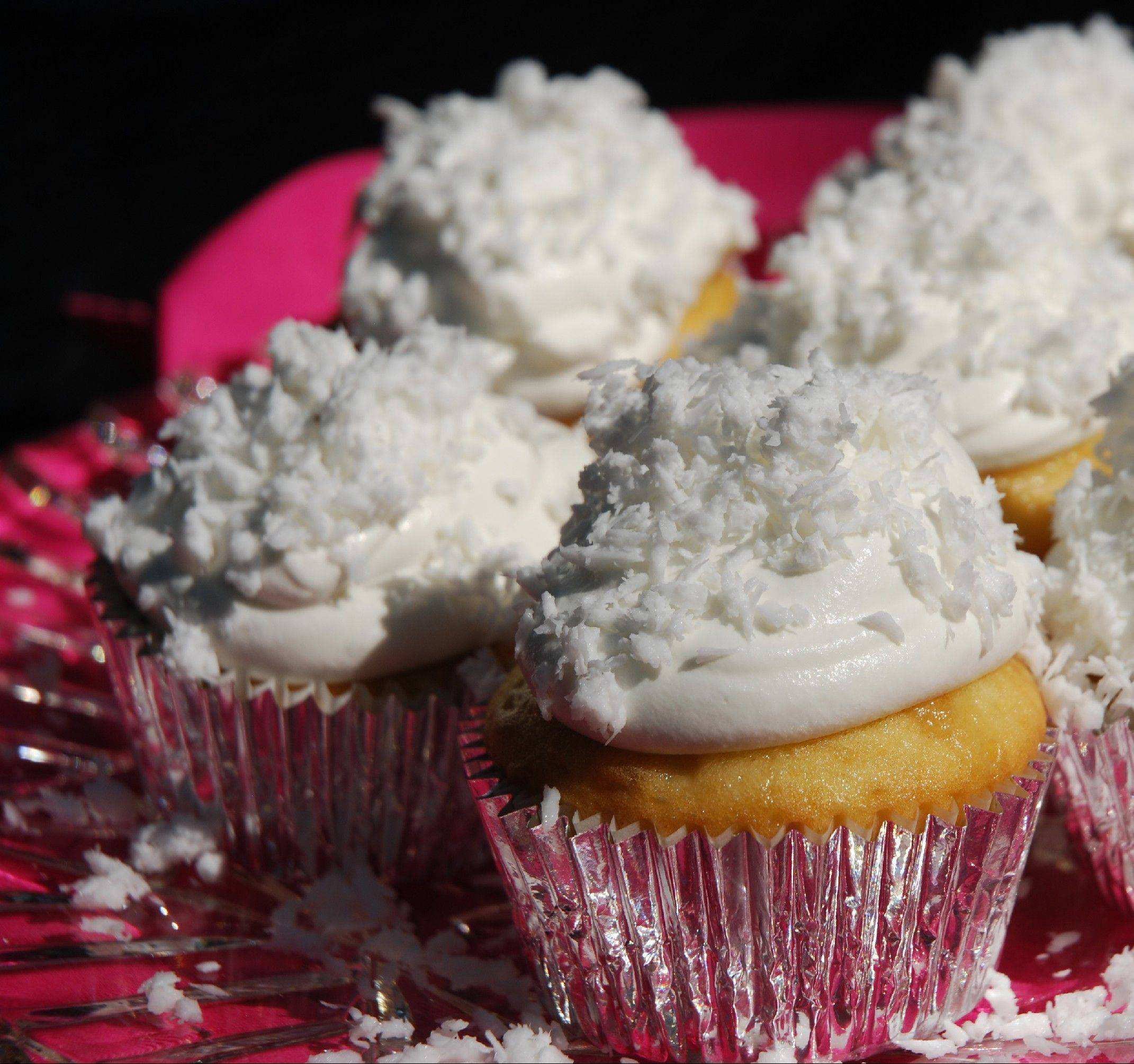 For the same price as one gourmet shop cupcake you can bake two dozen of these Cuckoo Coconut Cupcakes at home.