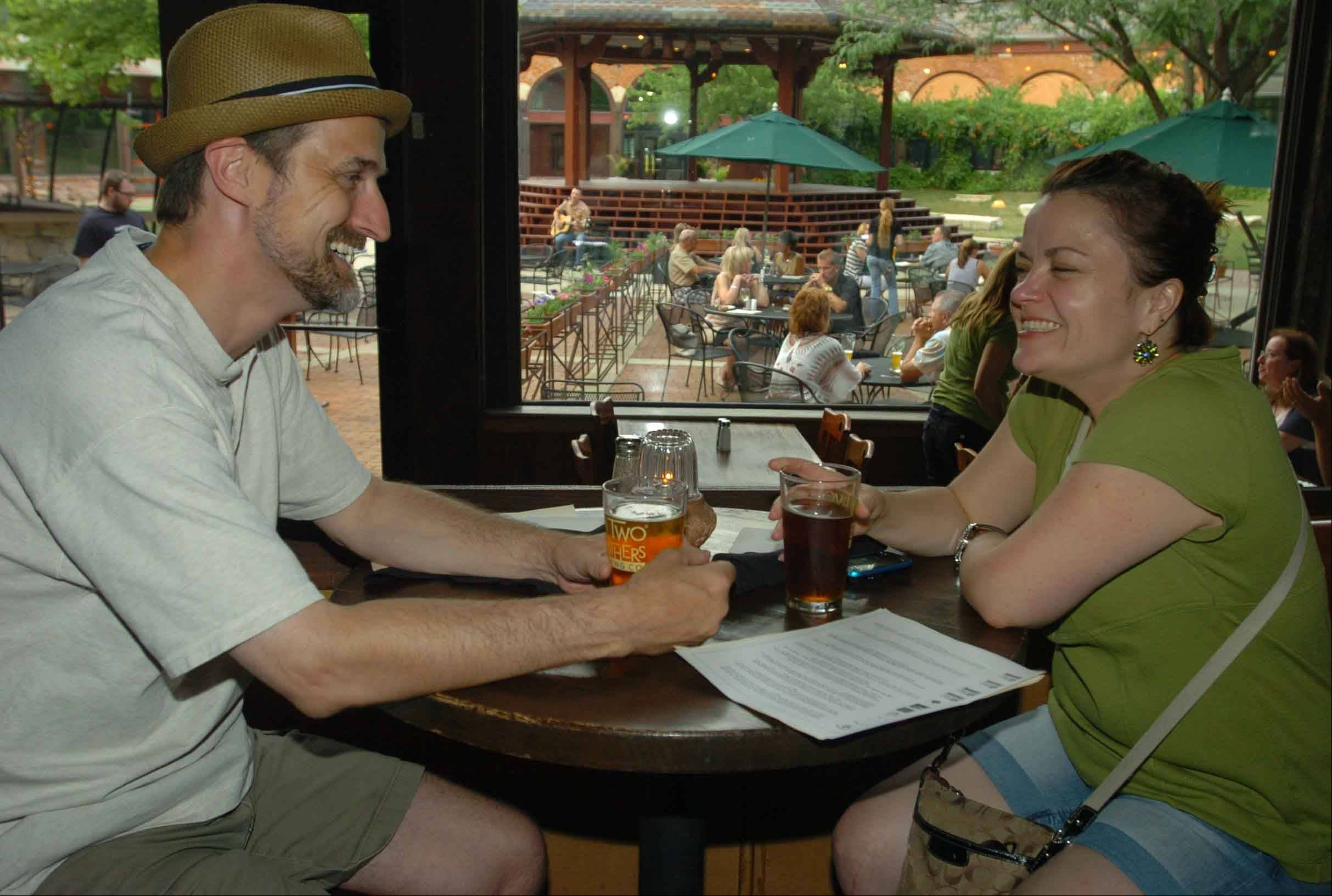 Patrick Zirkelbach and his wife, Robyn, enjoy a beer at Two Brothers Roundhouse in Aurora.