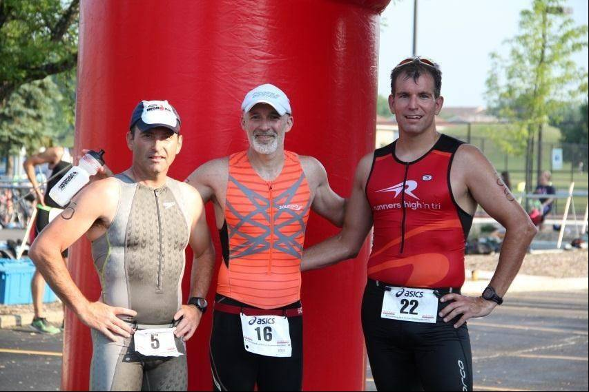 Timothy Suter, Dean Hewson and Eric Dewitt pose near the finish line after completing the Splash, Pedal, Dash Triathlon. Hewson was the overall male triathlon winner at 1:03:54. Dewitt finished at 1:06:14 and Suter at 1:09:09.