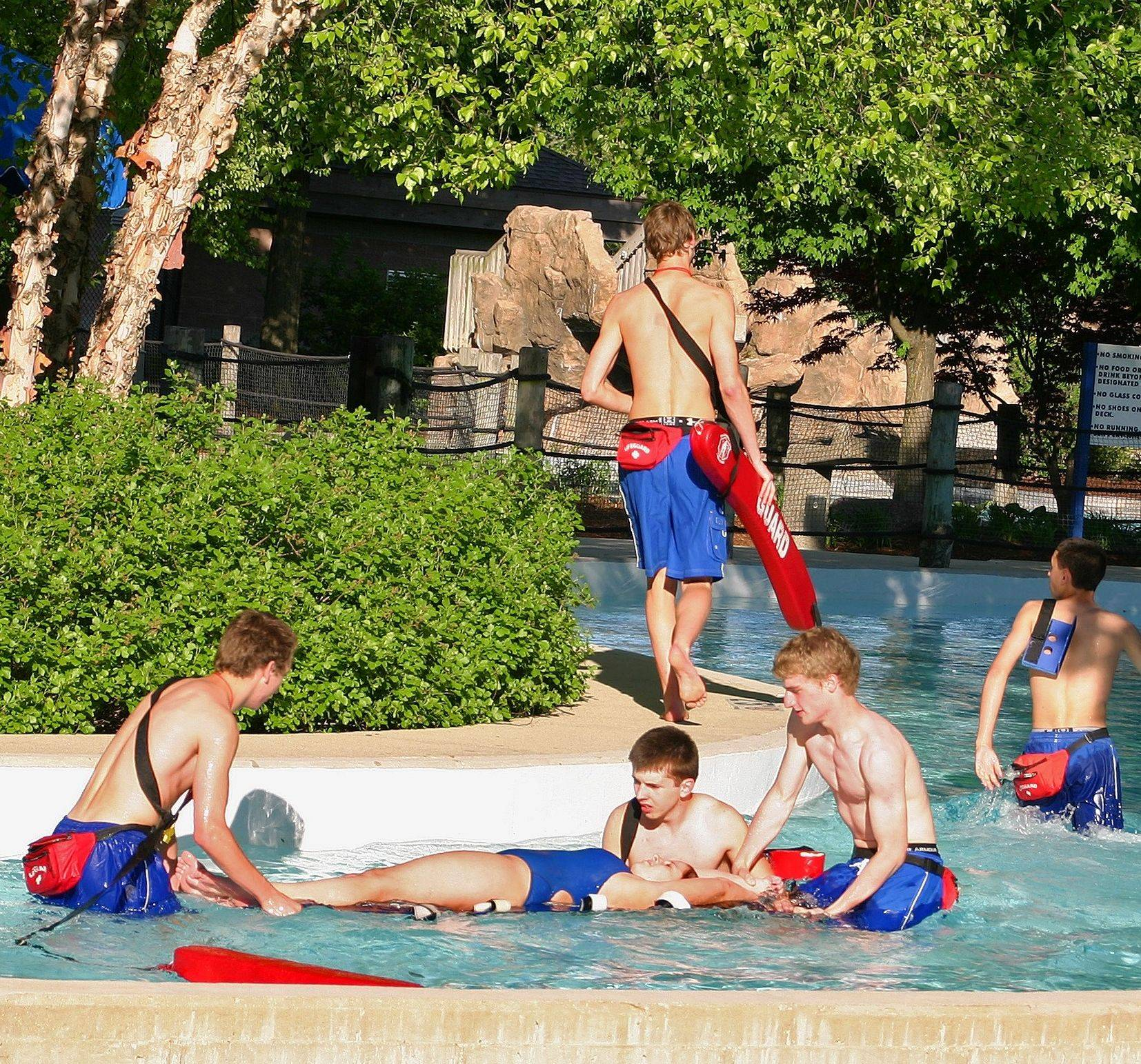 During in-service training before the 2011 pool season, lifeguards practice created emergency life-saving scenarios at Mystic Waters.