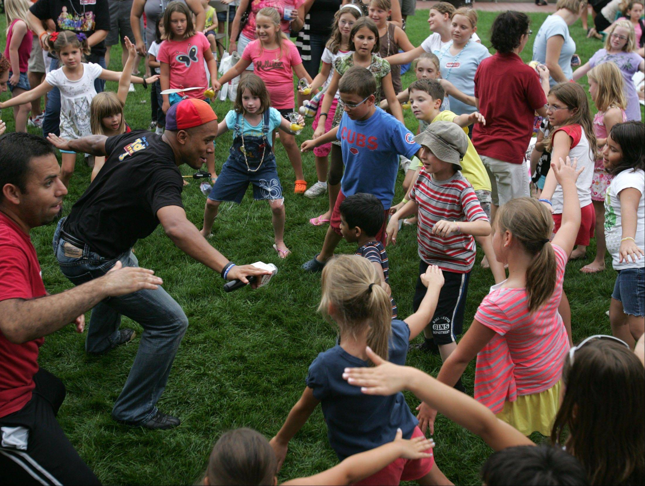 About 100 kids join in dancing at the 2010 Downtown Block Party, sponsored by the Mount Prospect Chamber of Commerce.