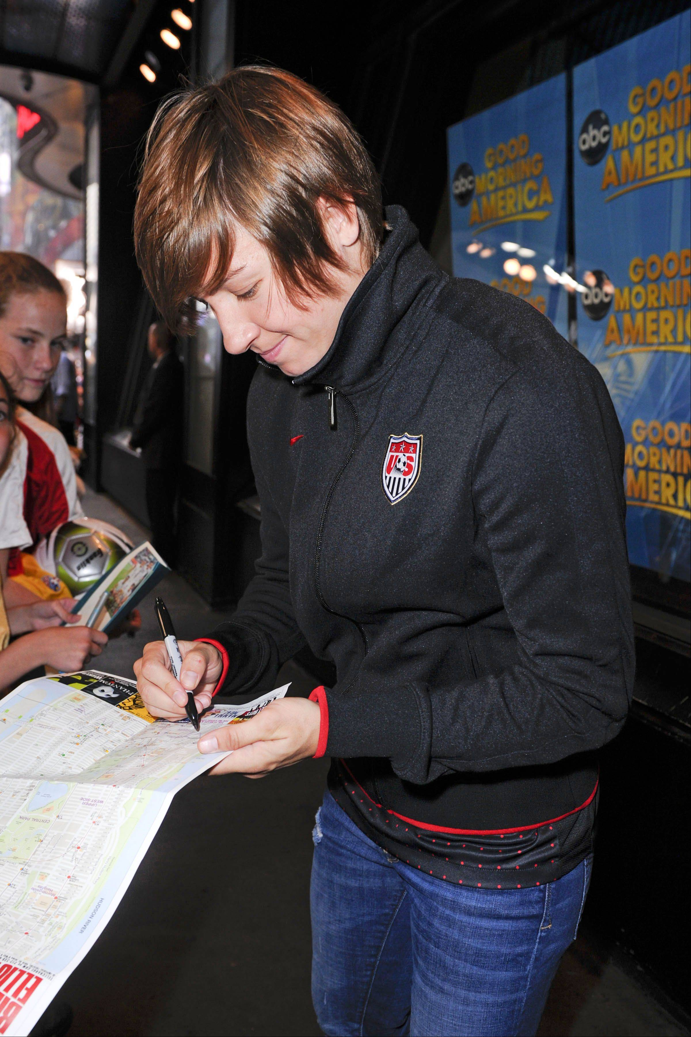 "Amy LePeilbet signs autographs before the U.S. Women's National Soccer Team's appearance on ""Good Morning America."" The team finished second to Japan at the FIFA Women's World Cup in Germany."
