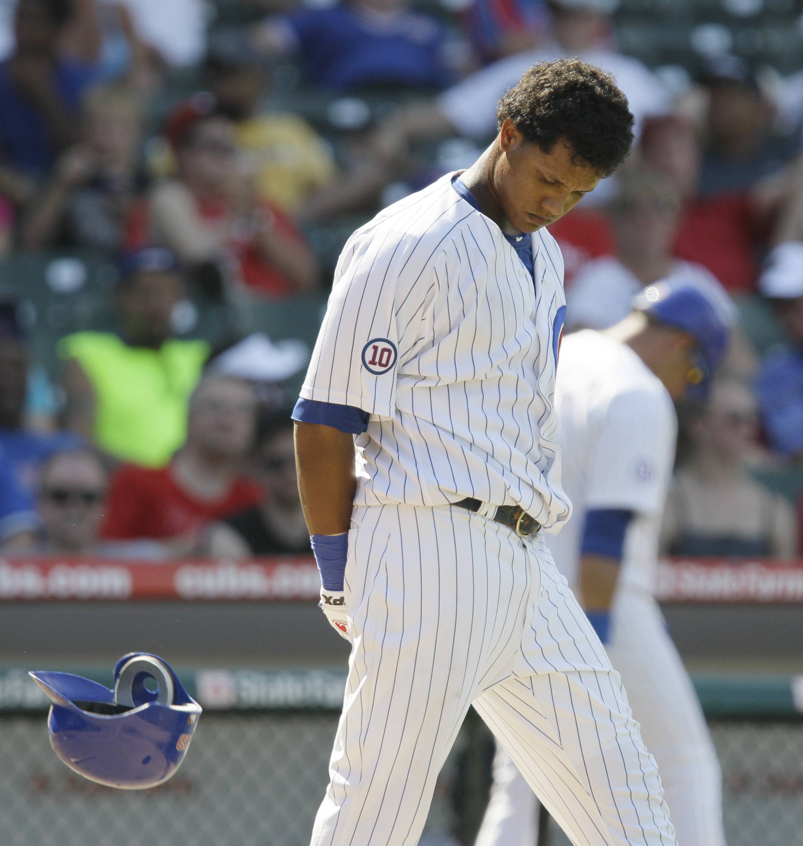 Starlin Castro reacts after striking out during the eighth inning against the Philadelphia Phillies Wednesday at Wrigley Field. The Cubs lost 9-1.