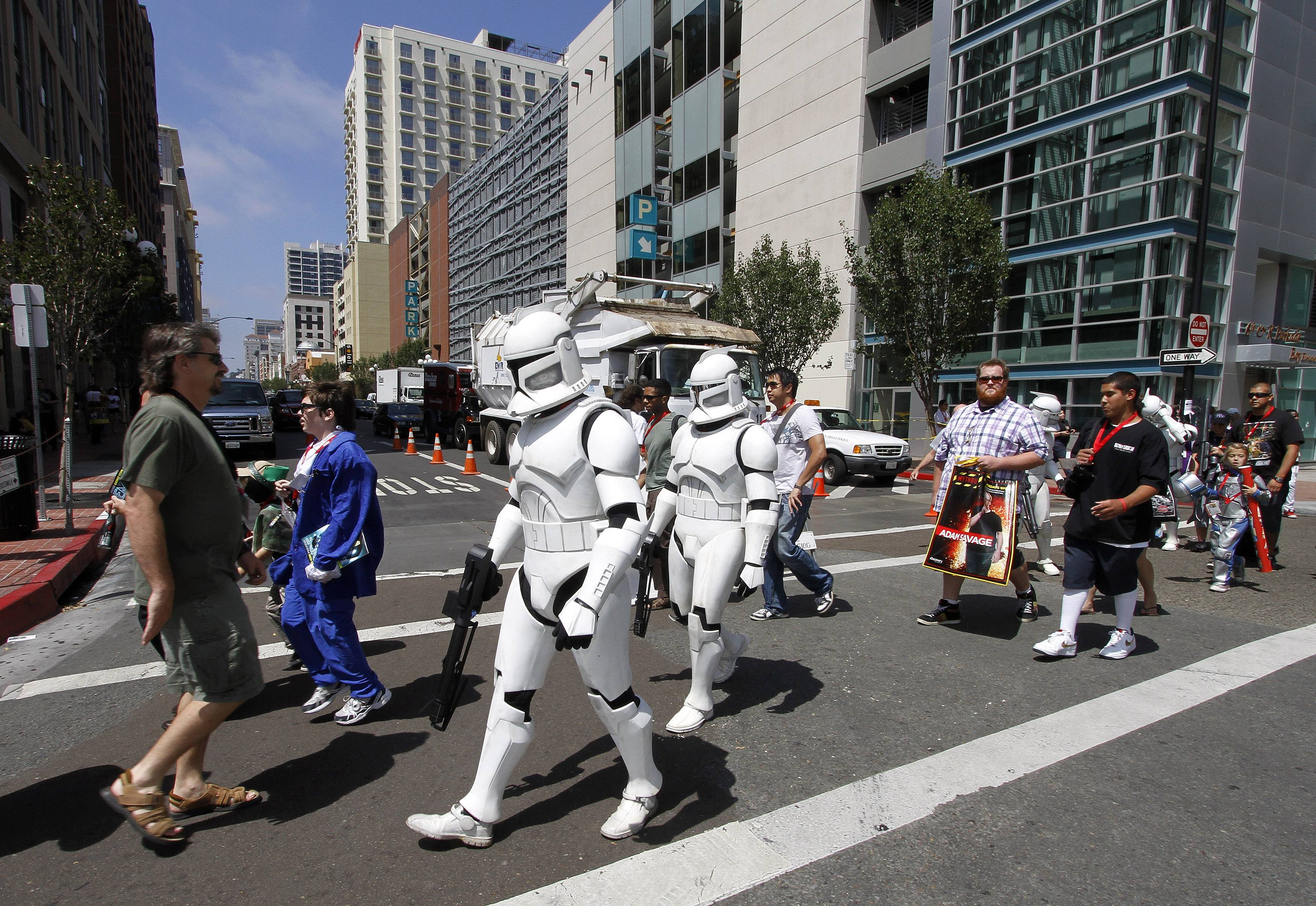 Comic-Con fans dressed in Star Wars costumes gear up for last year's convention in San Diego. This year's fest opens Thursday.