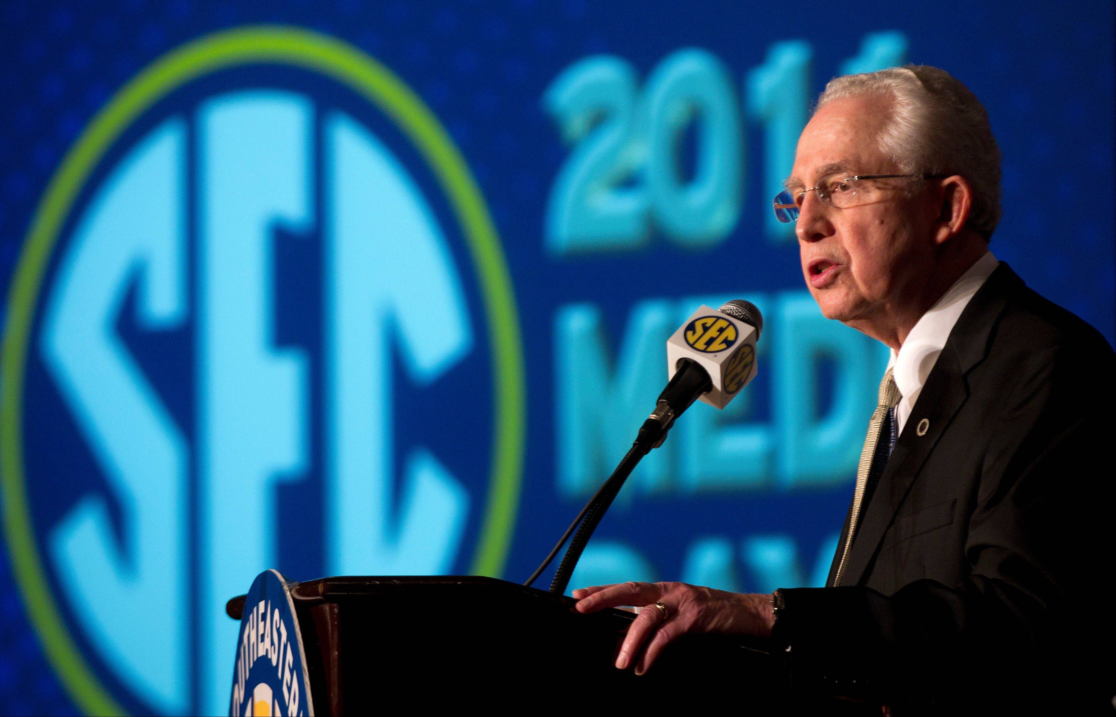 Southeastern Conference Commissioner Mike Slive talks with reporters during Southeastern Conference Football Media Days in Birmingham, Ala., on Wednesday.