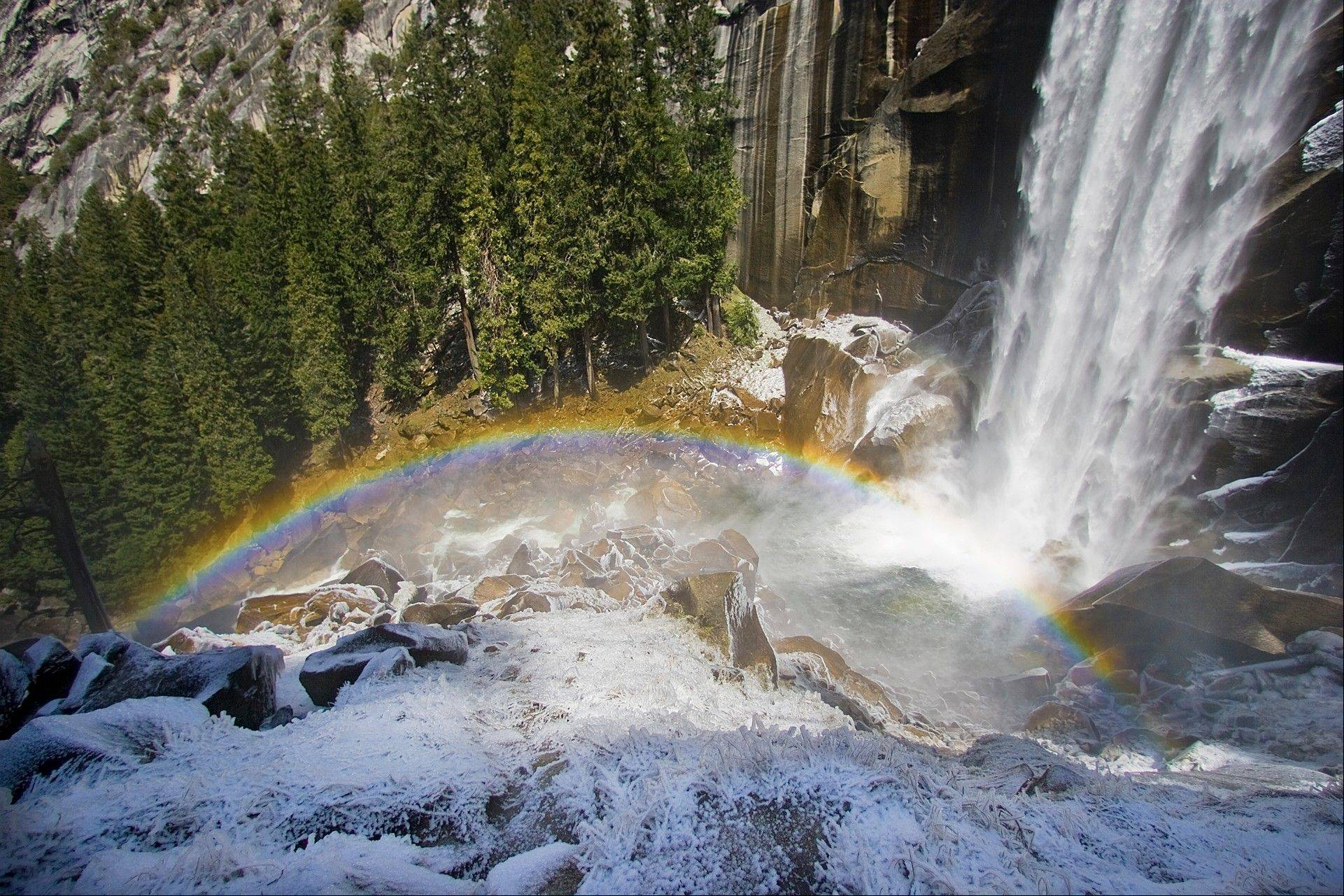 Ice forms around a rainbow at the base of Vernal Falls on the Mist Trail in Yosemite National Park in a photo from April 2009. Search and rescue rangers at Yosemite National Park were scouring an area below the popular waterfall after witnesses reported seeing at least three people swept over the falls.