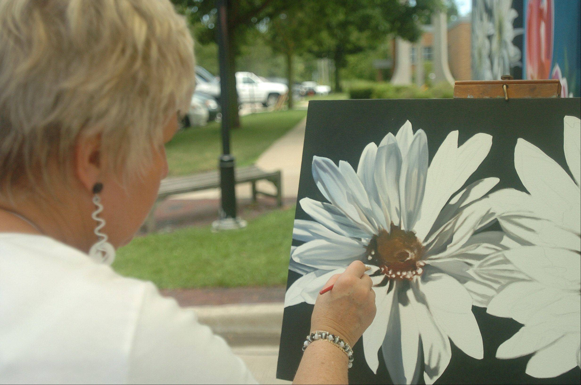 Marge Hall of Winfield paints a flower portrait during last year's Geneva Arts Fair.