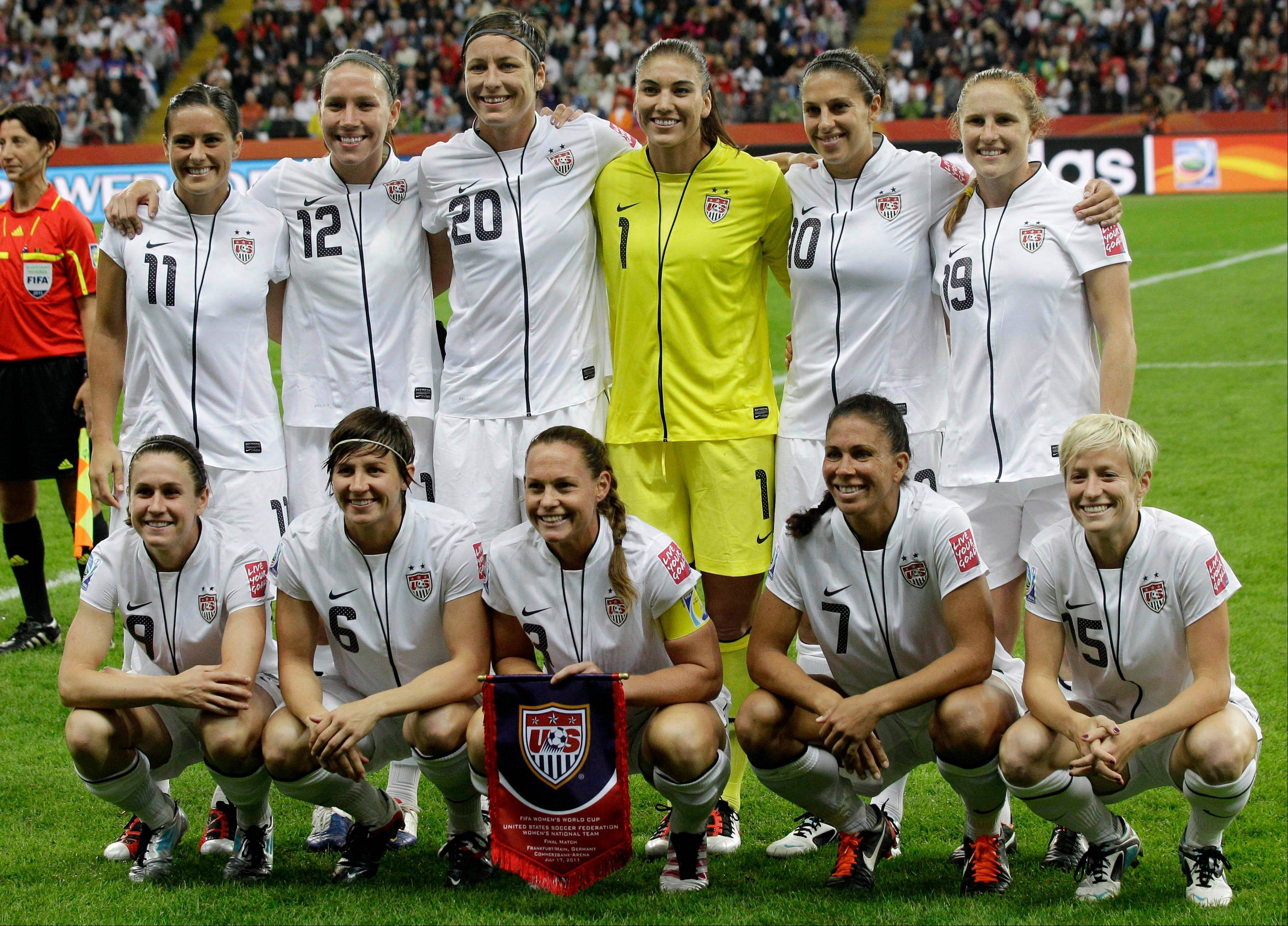 United States' Alex Krieger, from top left, Lauren Cheney, Abby Wambach, Hope Solo, Carli Lloyd and Rachel Buehler and, from bottom left, Heather O'Reilly, Amy LePeilbet, Christie Rampone, Shannon Boxx and Megan Rapinoe, pose for a team photo before Sunday's final match against Japan.