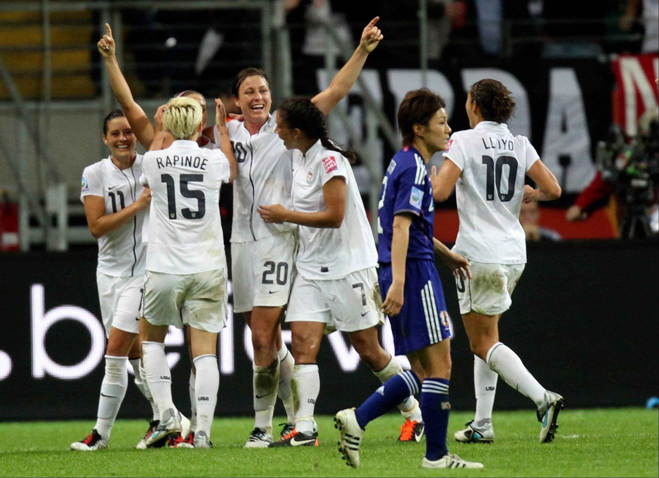 U.S. players celebrate scoring the opening goal Sunday during the final match between Japan and the United States at the Women's Soccer World Cup in Frankfurt, Germany. Japan would go on to win after penalty kicks.