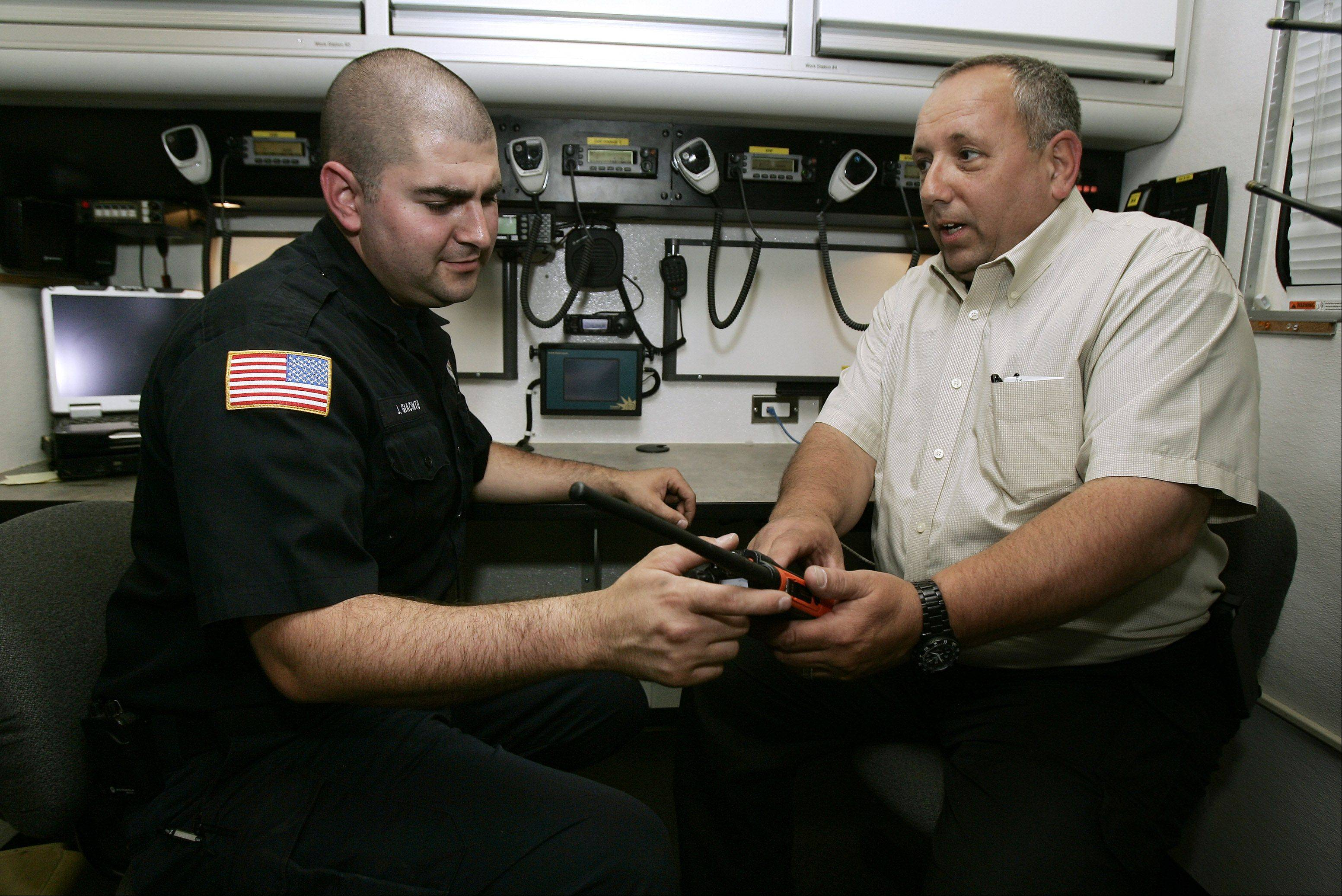 Wauconda Fire Department Chief Dave Dato, right, and Jeff Giacinto, command unit leader, explains the equipment in the Unified Command Post, an emergency mobile communications van, housed at the Volo fire substation.
