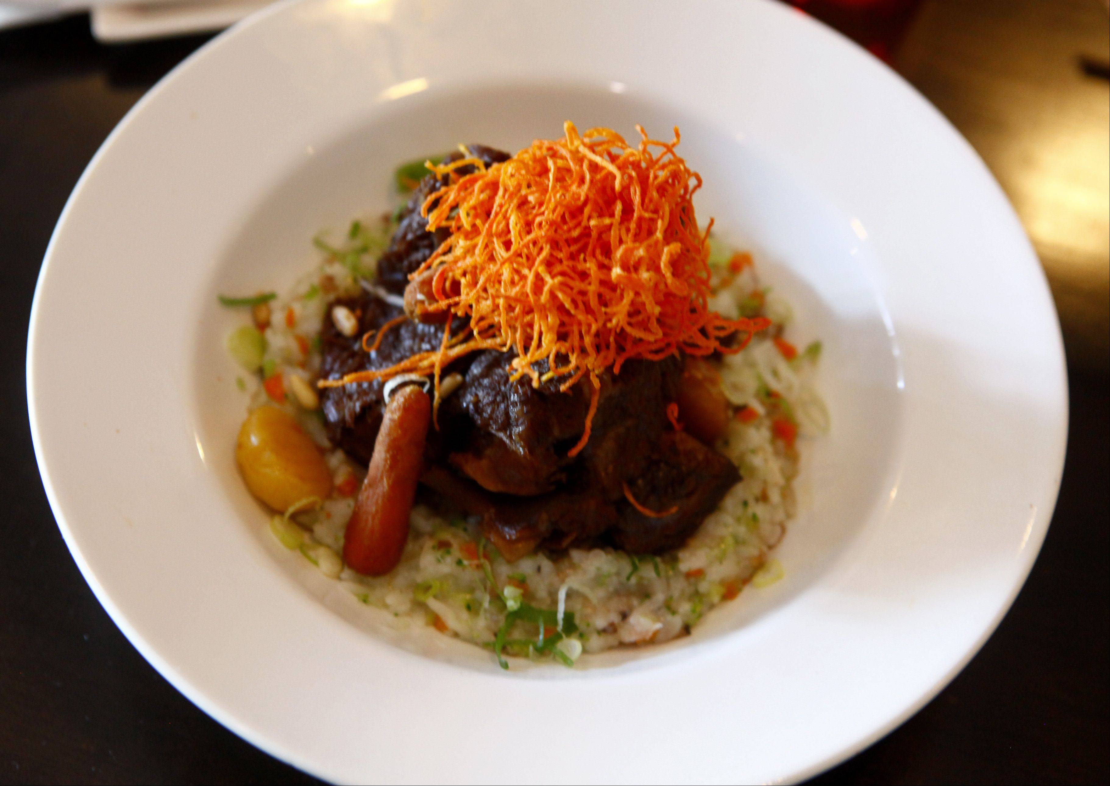 Ttowa's kalbijjim -- a dish of braised beef -- comes with rice vegetable porridge, crispy carrots, pine nuts and chestnuts.