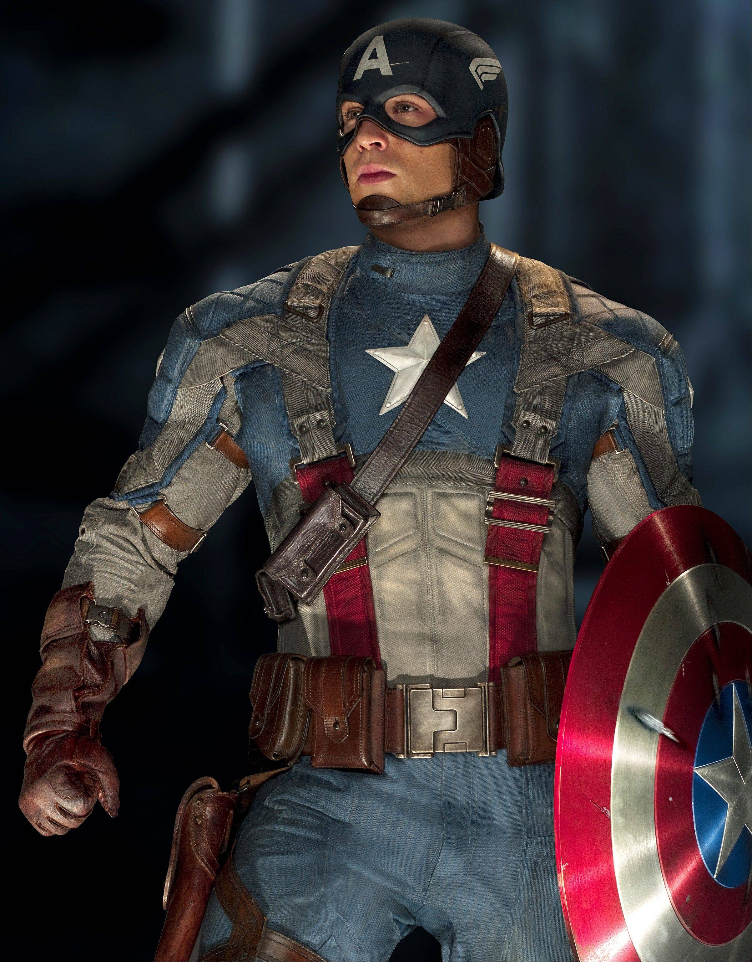 "Former wimp Steve Rogers (Chris Evans) battles the Nazis as a red, white and blue superhero in ""Captain America: The First Avenger."""