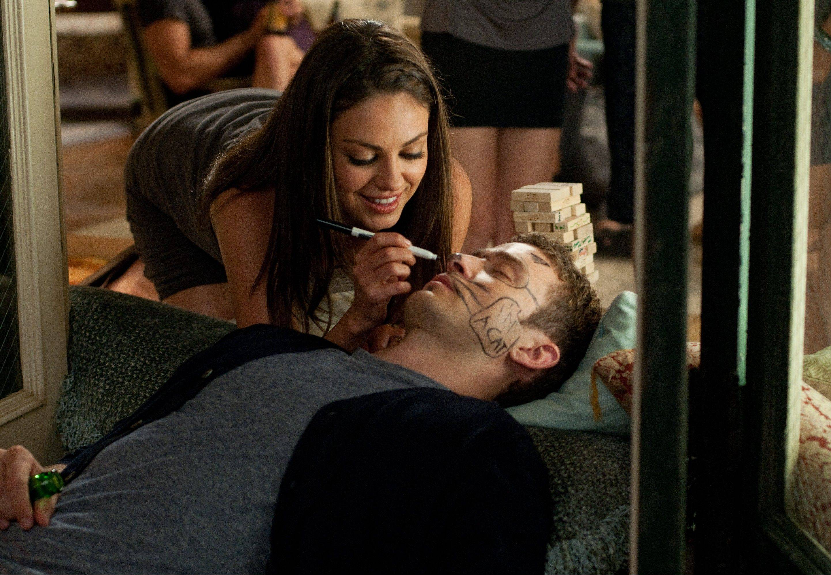 "Jamie (Mila Kunis) has a little fun at Dylan's (Justin Timberlake) expense in ""Friends With Benefits."""