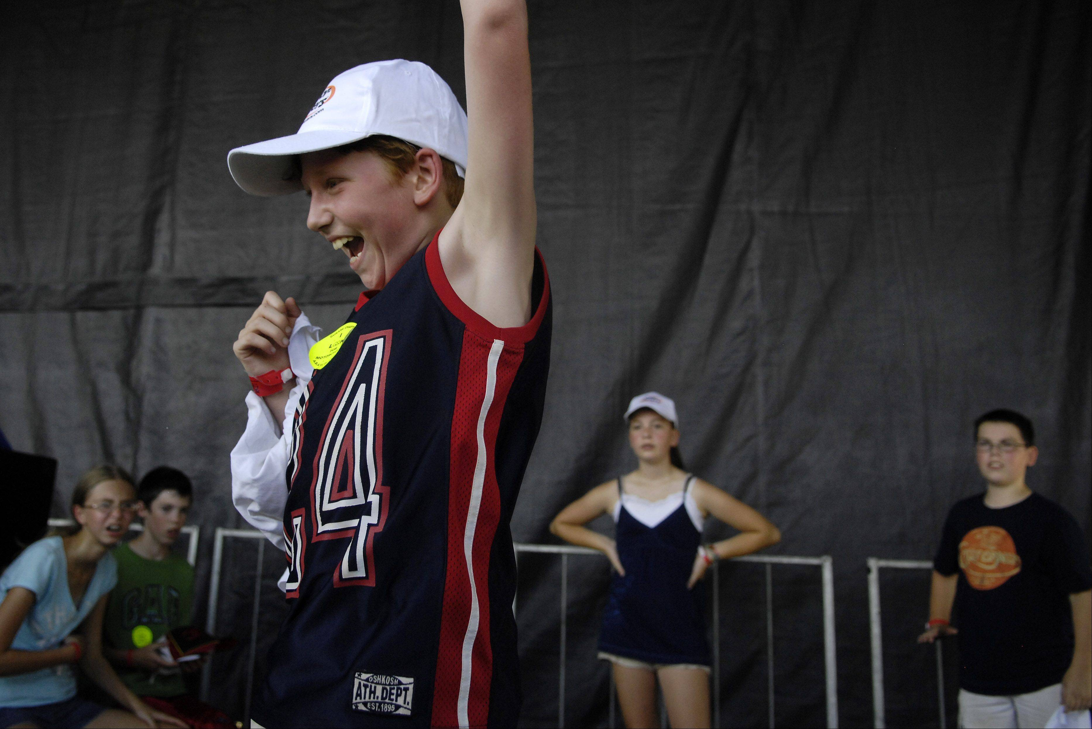 "10-year-old Benjamin Wehrle of West Dundee is thrilled to be given the dubious honor of being named the winner of the Odor Eaters Rotten Sneaker Contest at the Kane County Fair in St. Charles Thursday. The upside of having the stinkiest shoes was a 200-dollar prize. He said his secret was ""all kinds of manure."""