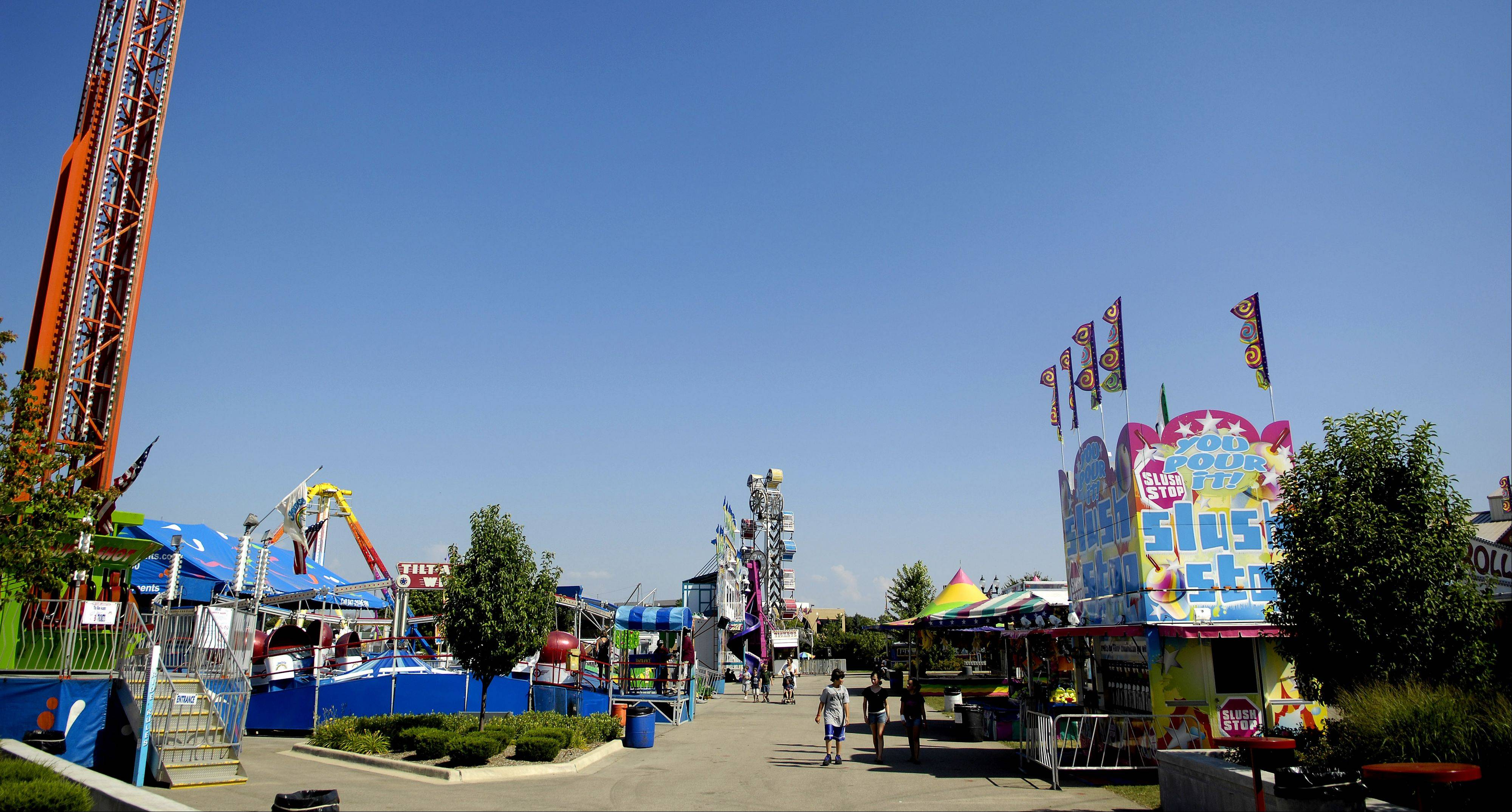 Temperatures near 100 degrees kept attendance very low Thursday afternoon during day two of the Kane County Fair in St. Charles.