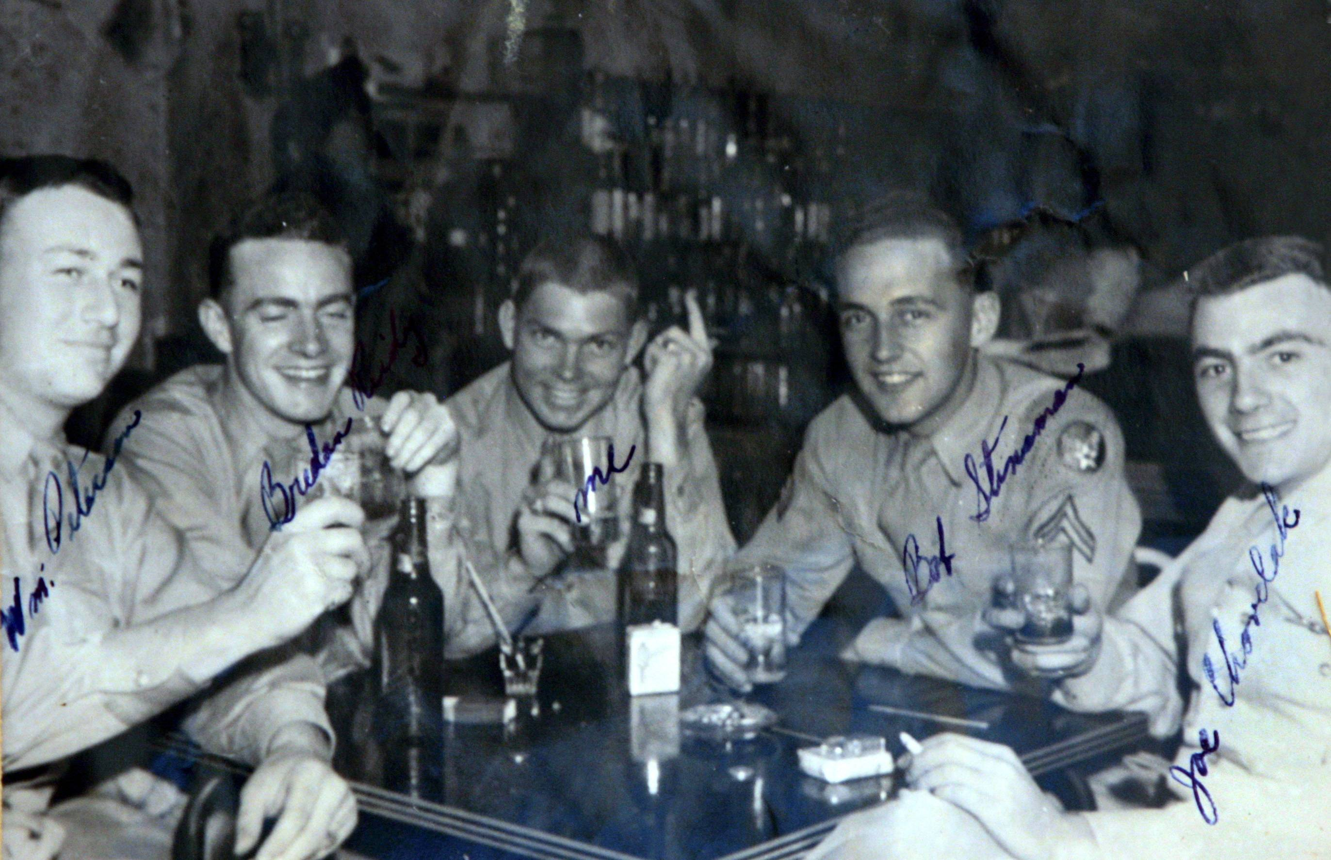 Naperville resident Joe Chovelak, far right, was a member of the 29th Bomb Squadron in the 20th Air Force Division during World War II. He was stationed in Guam for six months at the end of the war and will fly again in a B-29 on Saturday.