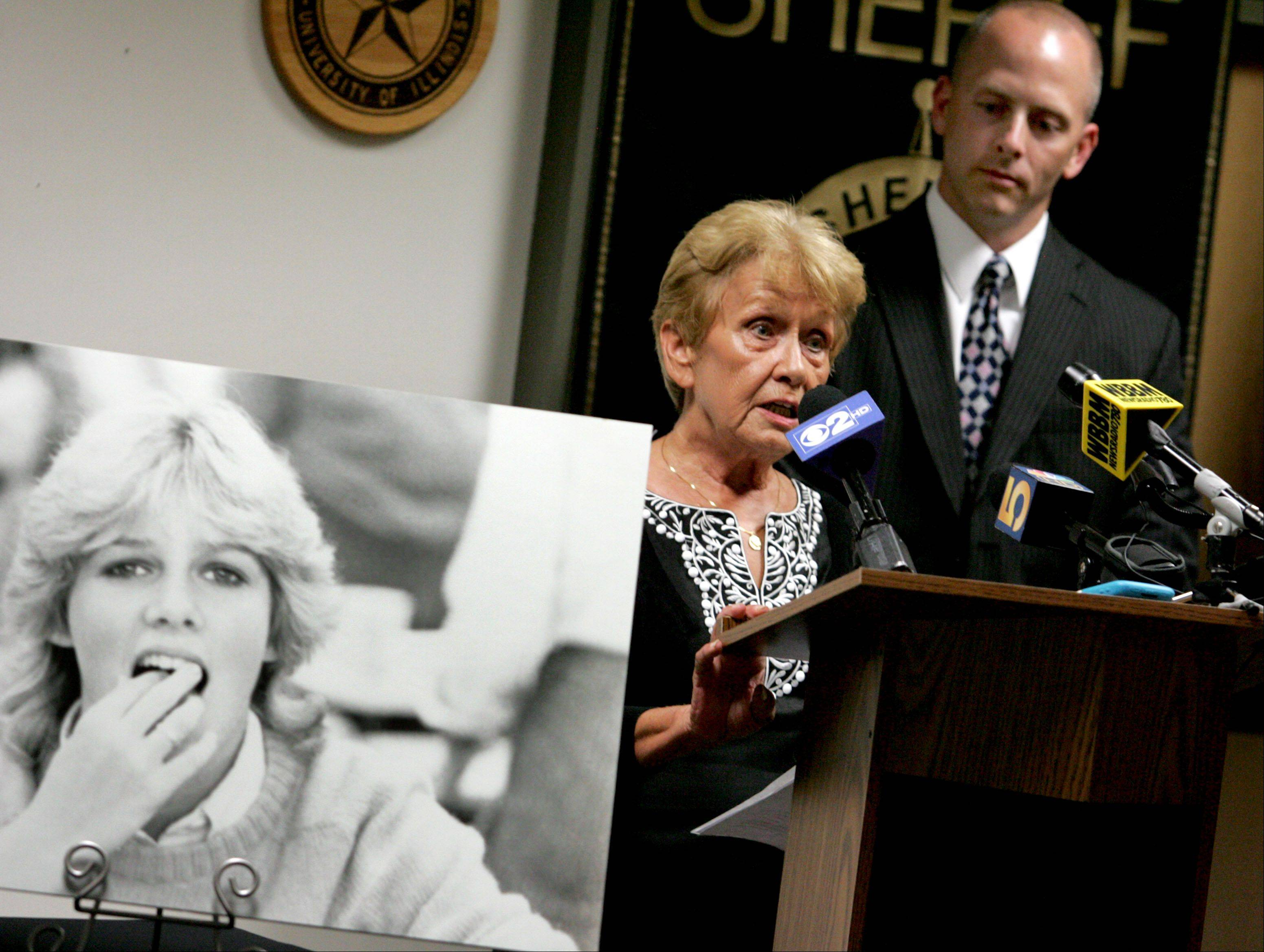 Sandy Wesselman speaks at a news conference at the DuPage County sheriff's office in Wheaton about new strategies in the investigation of her daughter Kristy's murder 26 years ago near Glen Ellyn. On the right is Sgt. Robert Harris.