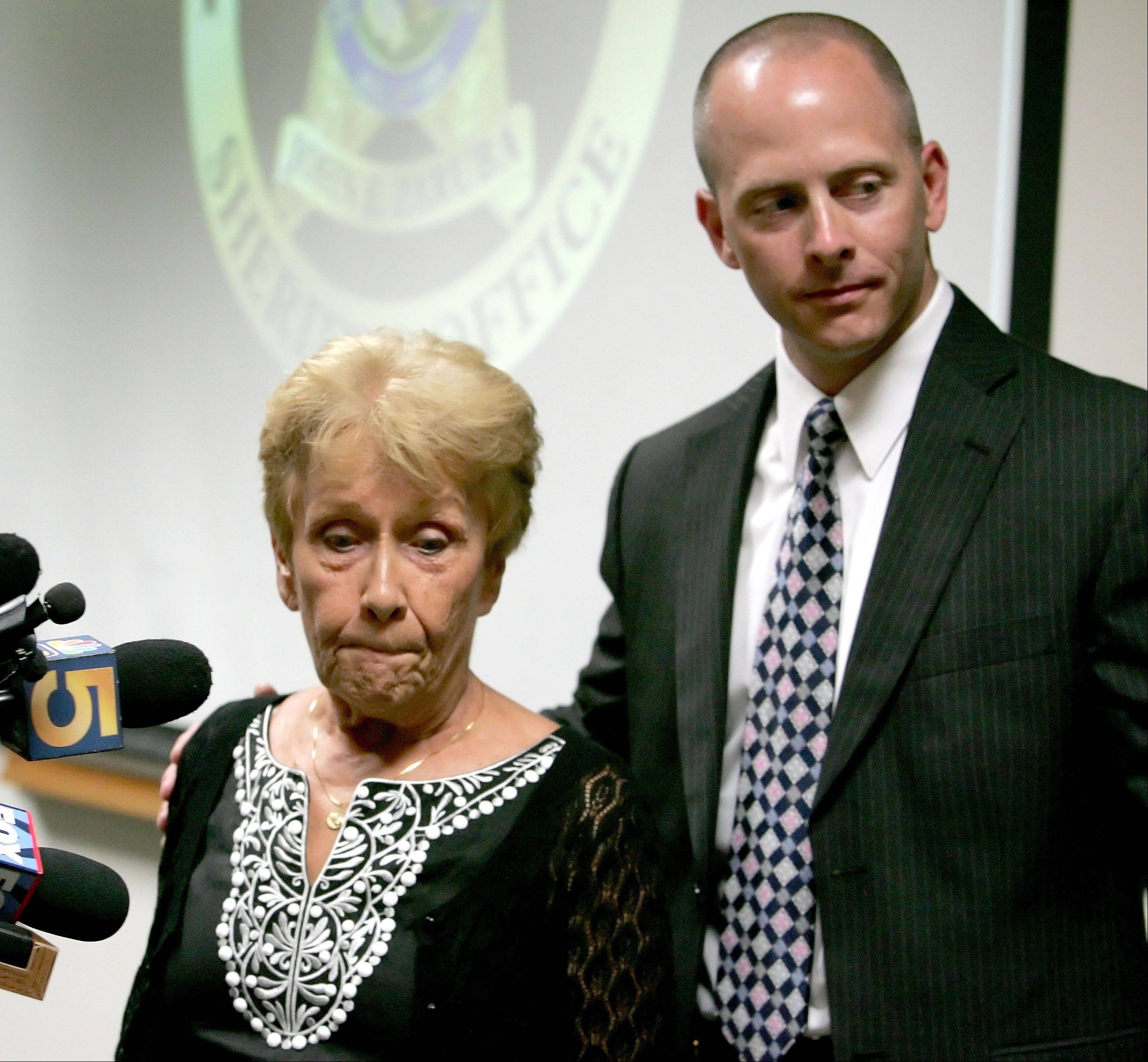 Sandy Wesselman finishes speaking at a news conference at the DuPage County sheriff's office with Sgt. Robert Harris. Her daughter Kristy was murdered on July 21, 1985, near Glen Ellyn. The case remains unsolved.
