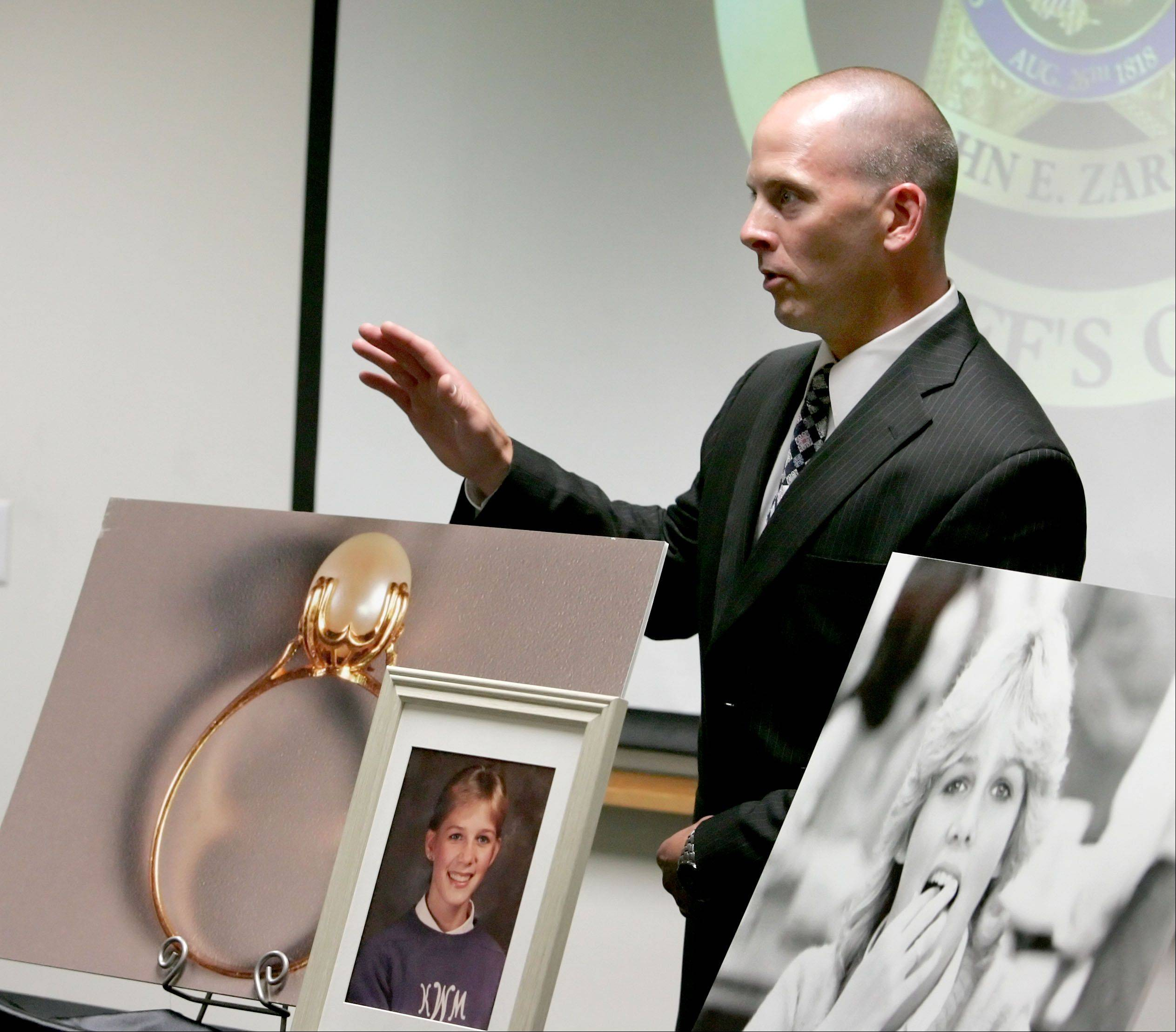 Sgt. Robert Harris reveals a photo of a ring during news conference at the DuPage County sheriff's office in Wheaton on Thursday. Kristy Wesselman was wearing a similar ring when she was murdered on July 21, 1985, near Glen Ellyn.