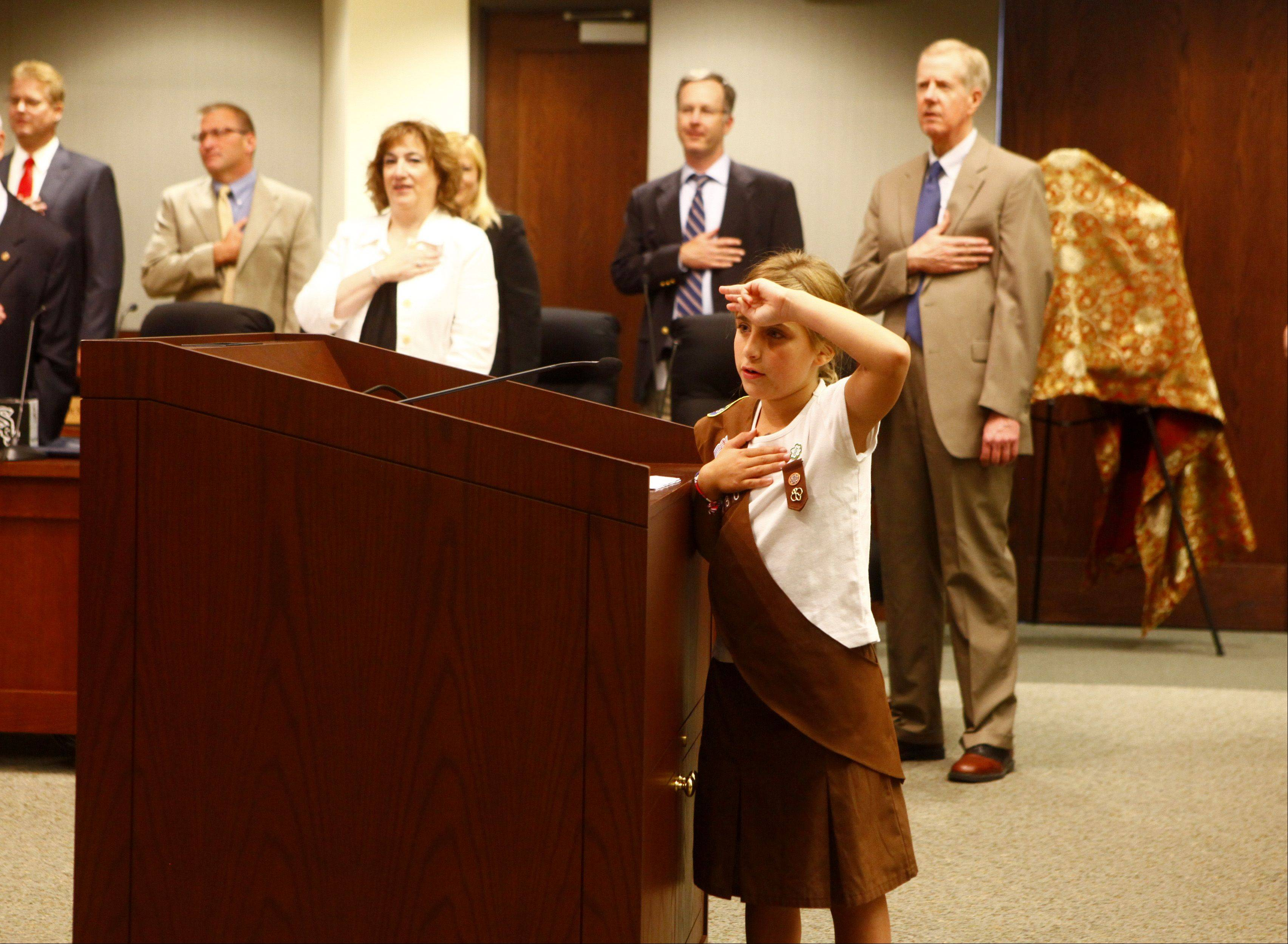 Sophie Scerbin leads the Pledge of Allegiance before the village board meeting.