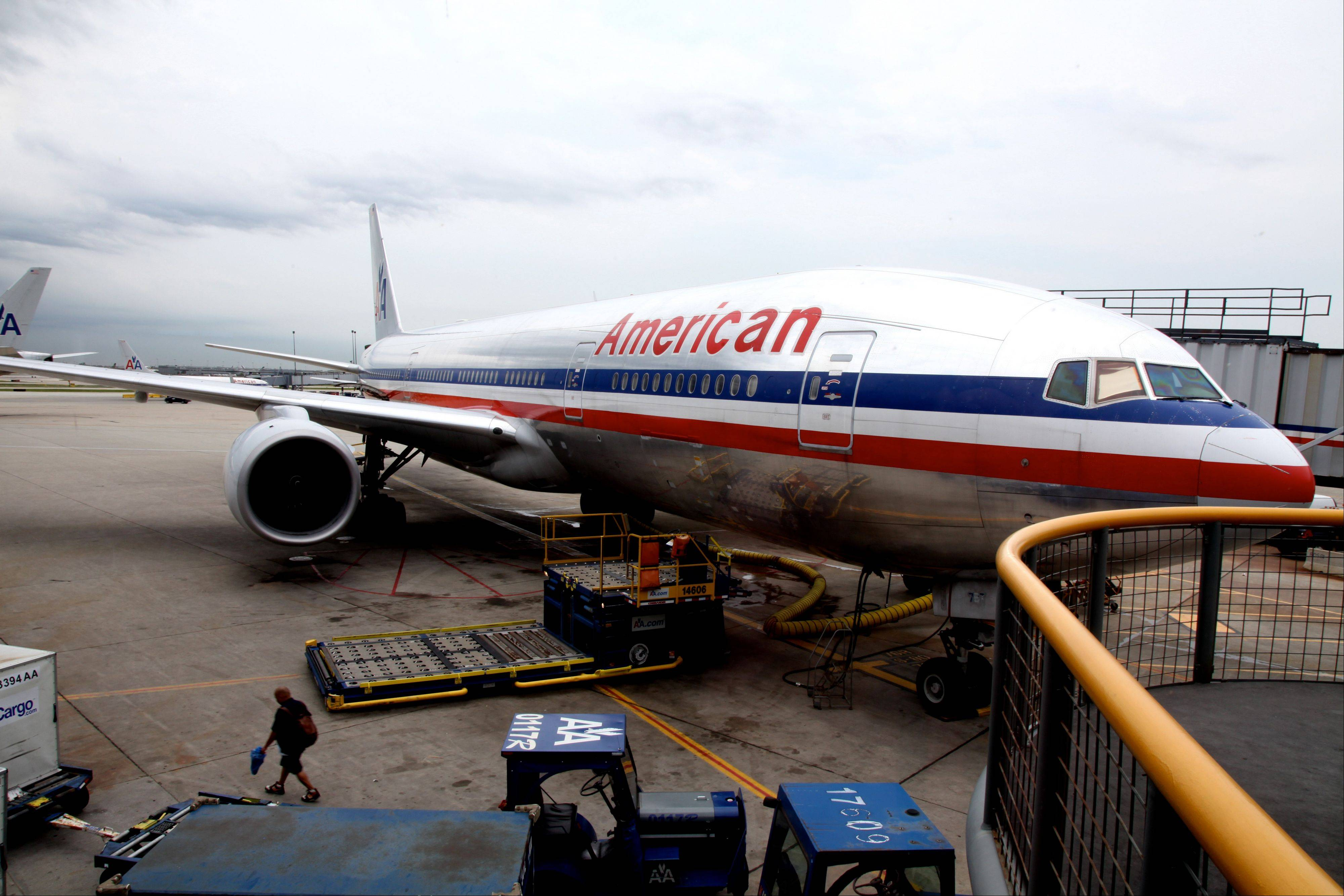 An American Airlines plane is parked at the terminal at O'Hare International airport. The government is delaying some airline consumer-protection rules to give the airlines more time to prepare for them.