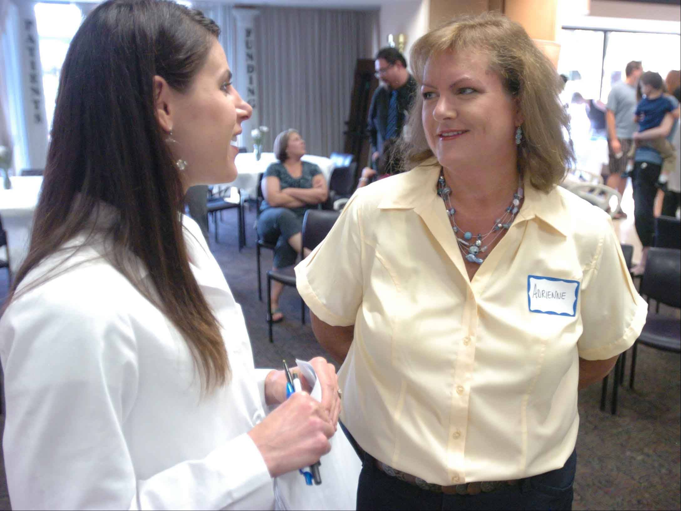 Dietitian Dana White, left, chats with Adrienne Wojcik of Downers Grove at Good Samaritan Hospital's third annual Bariatric Reunion Wednesday evening.
