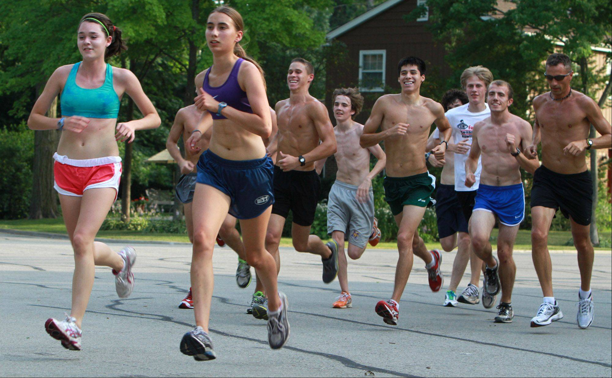 Runners finish a five-mile group run Tuesday in Arlington Heights, despite the extreme heat.