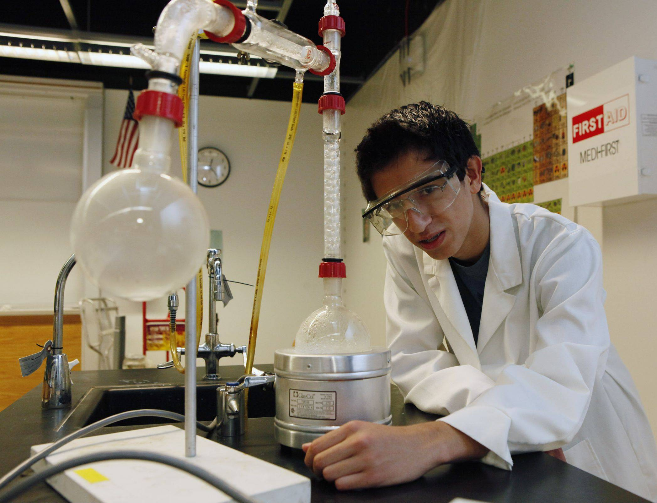 Nolan Maloney, an incoming senior at the Illinois Mathematics and Science Academy, works on a fractional distillation experiment.