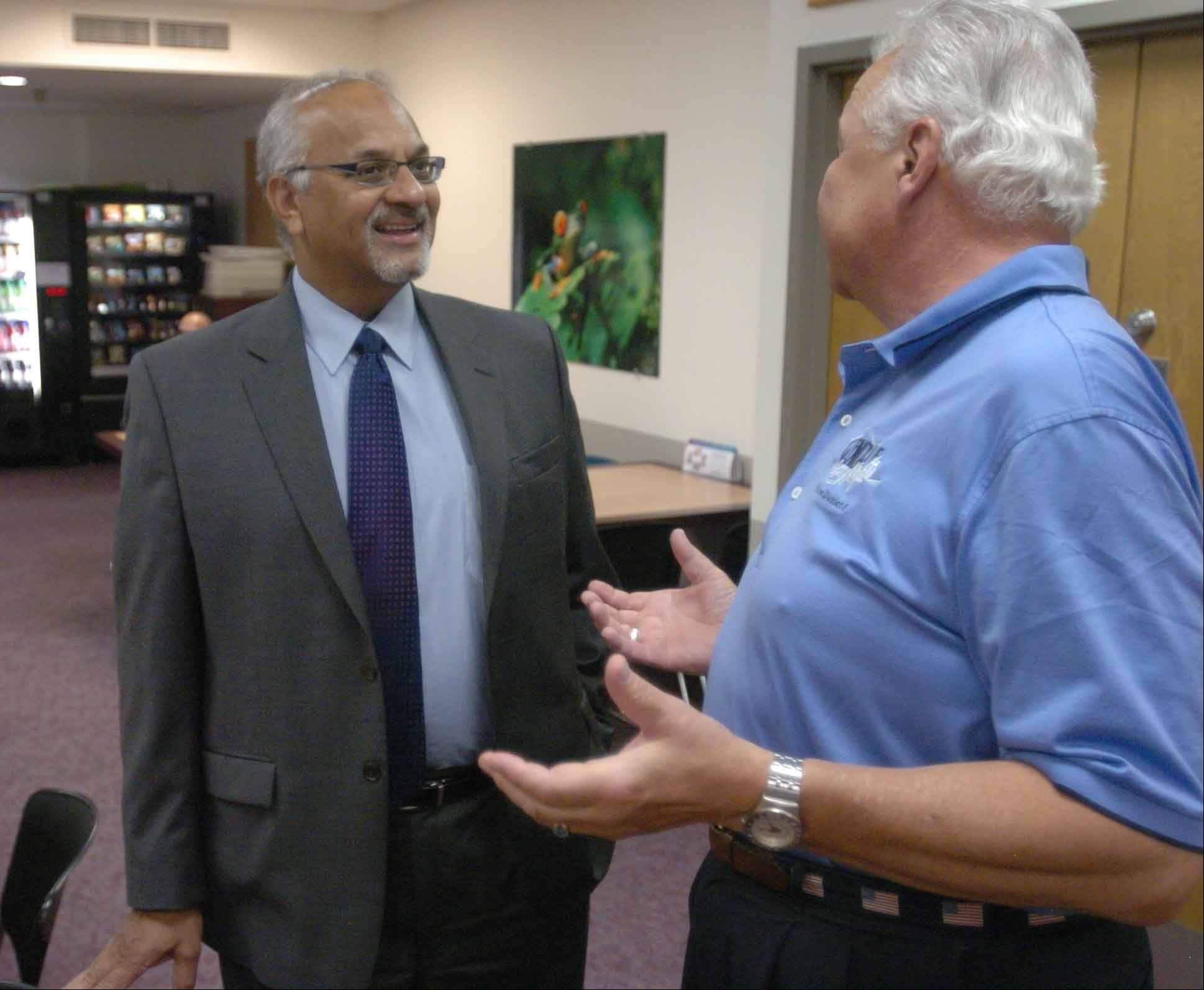 Adventist GlenOaks Hospital CEO Brinsley Lewis is leaving after 12 years as head of the Glendale Heights hospital. He talks with Glendale Heights Trustee Chester Pojack during a farewell celebration held Wednesday at the hospital.