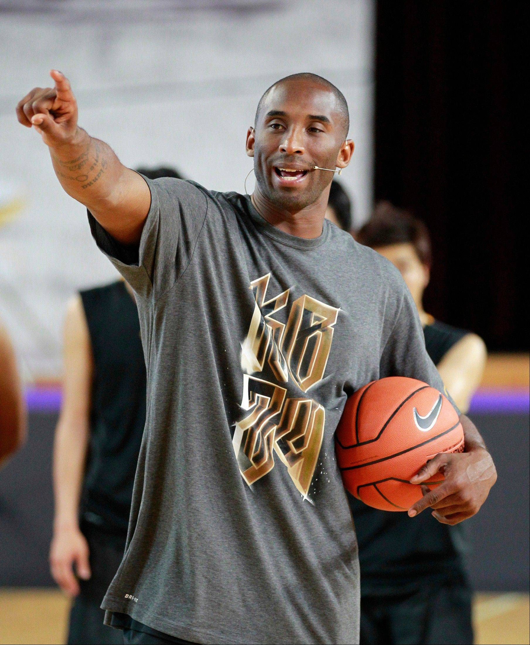 Lakers Kobe Bryant gives an instruction for South Korean students during his basketball clinic for youth in Seoul, South Korea, earlier this summer. Turkish club Besiktas says it is in talks to bring the star to Turkey to play during the NBA lockout.