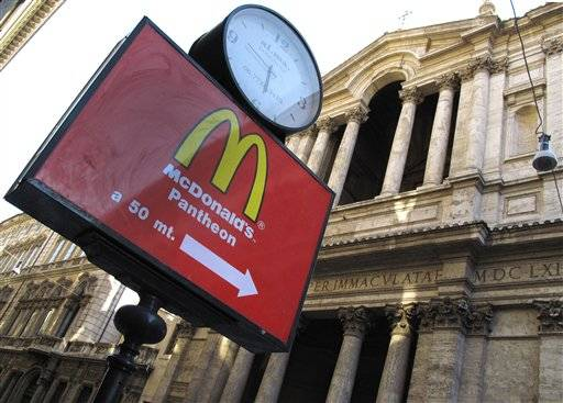 A sign points to the McDonald's restaurant near the historic Pantheon in Rome, Italy.