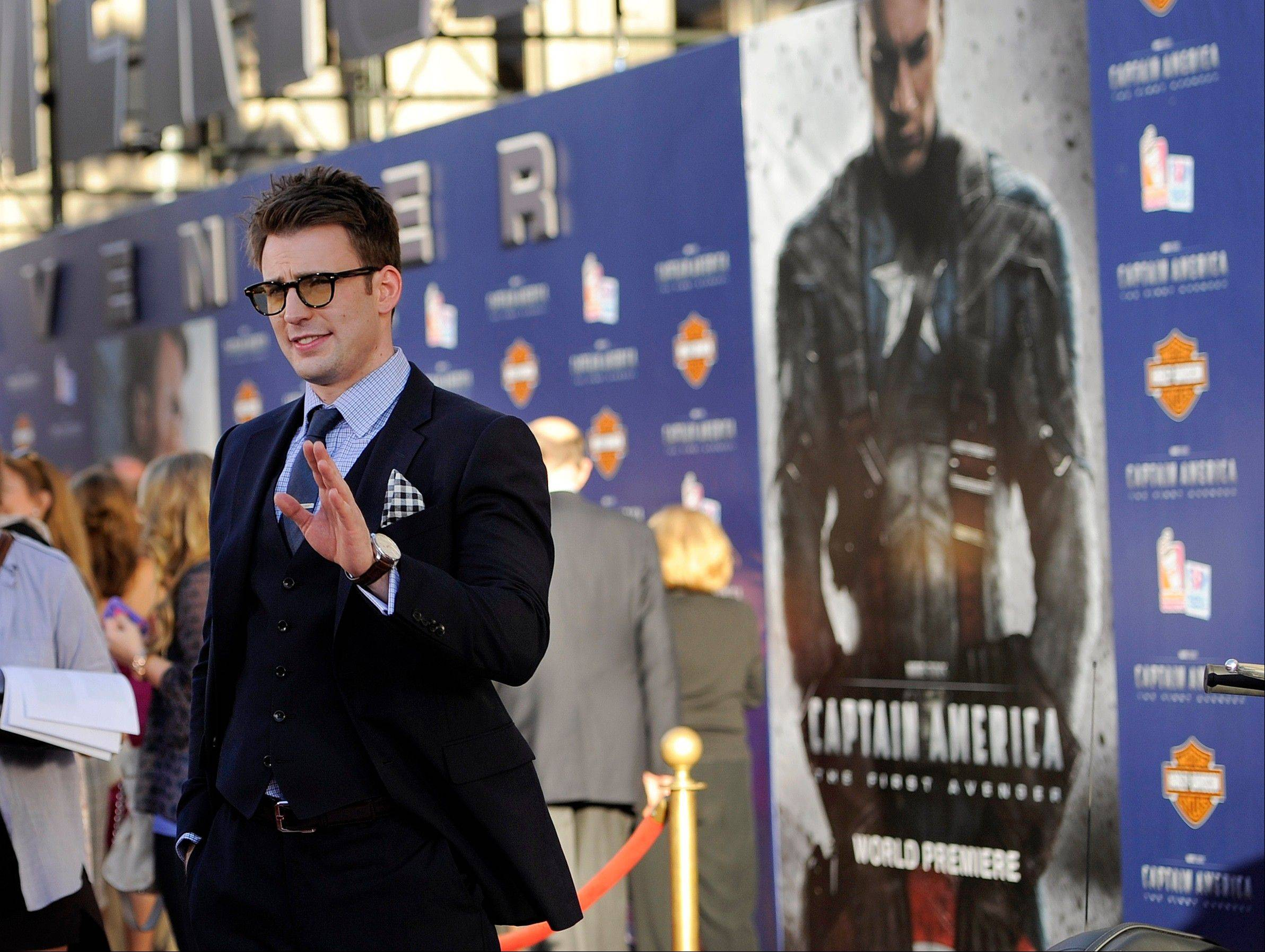 "Chris Evans, star of ""Captain America: The First Avenger,"" waves to photographers at the premiere of the film in Los Angeles."
