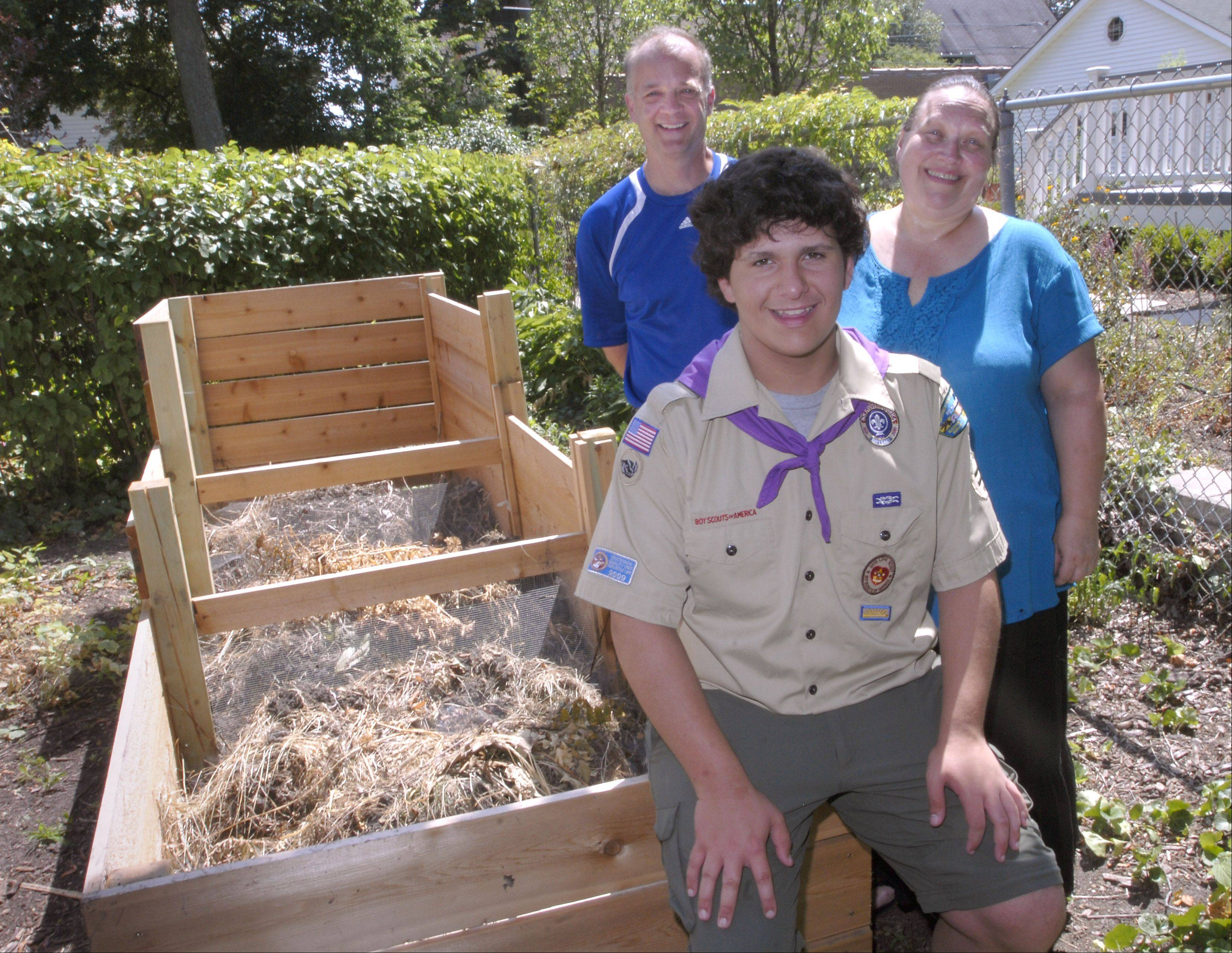Garden Clubbers Thom Kraak and Diane Bolash helped Chris Clarizio, 14, of Arlington Heights, design and build a three-section compost bin on the grounds of the Arlington Heights History Center for his Eagle Scout project.