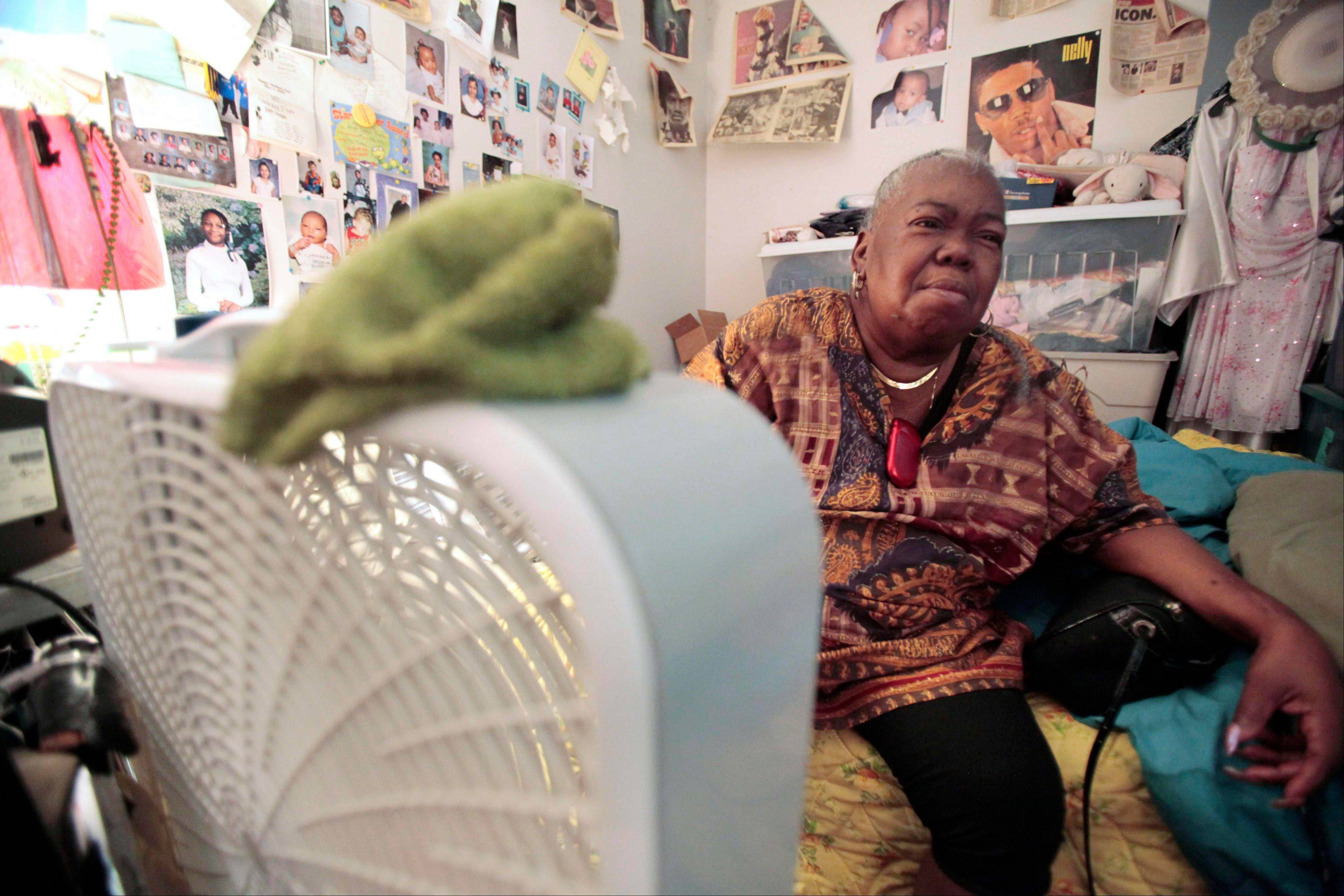 Chicago resident Mary Ware sits next to a fan in her basement apartment on Thursday. She can�t afford air-conditioning.