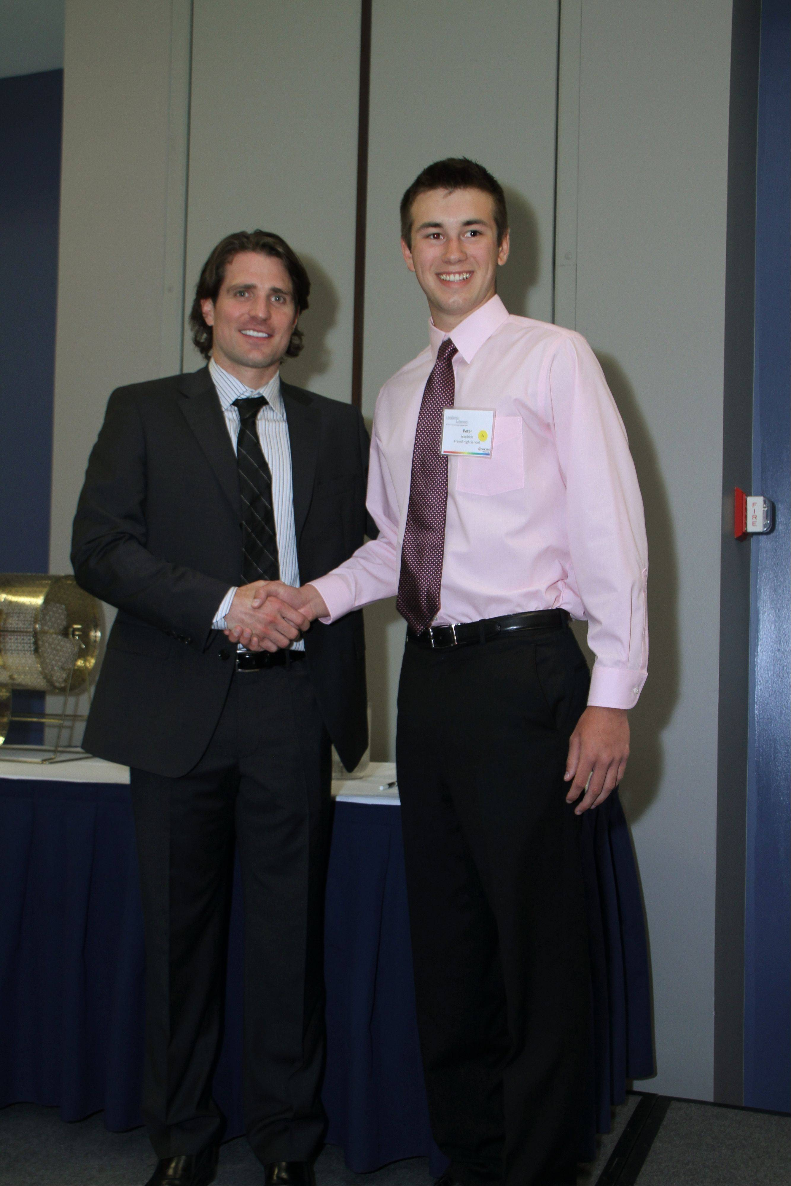 Chicago Black Hawk Patrick Sharp, left, congratulates Peter Ninchich on his Comcast Leaders and Achievers scholarship.