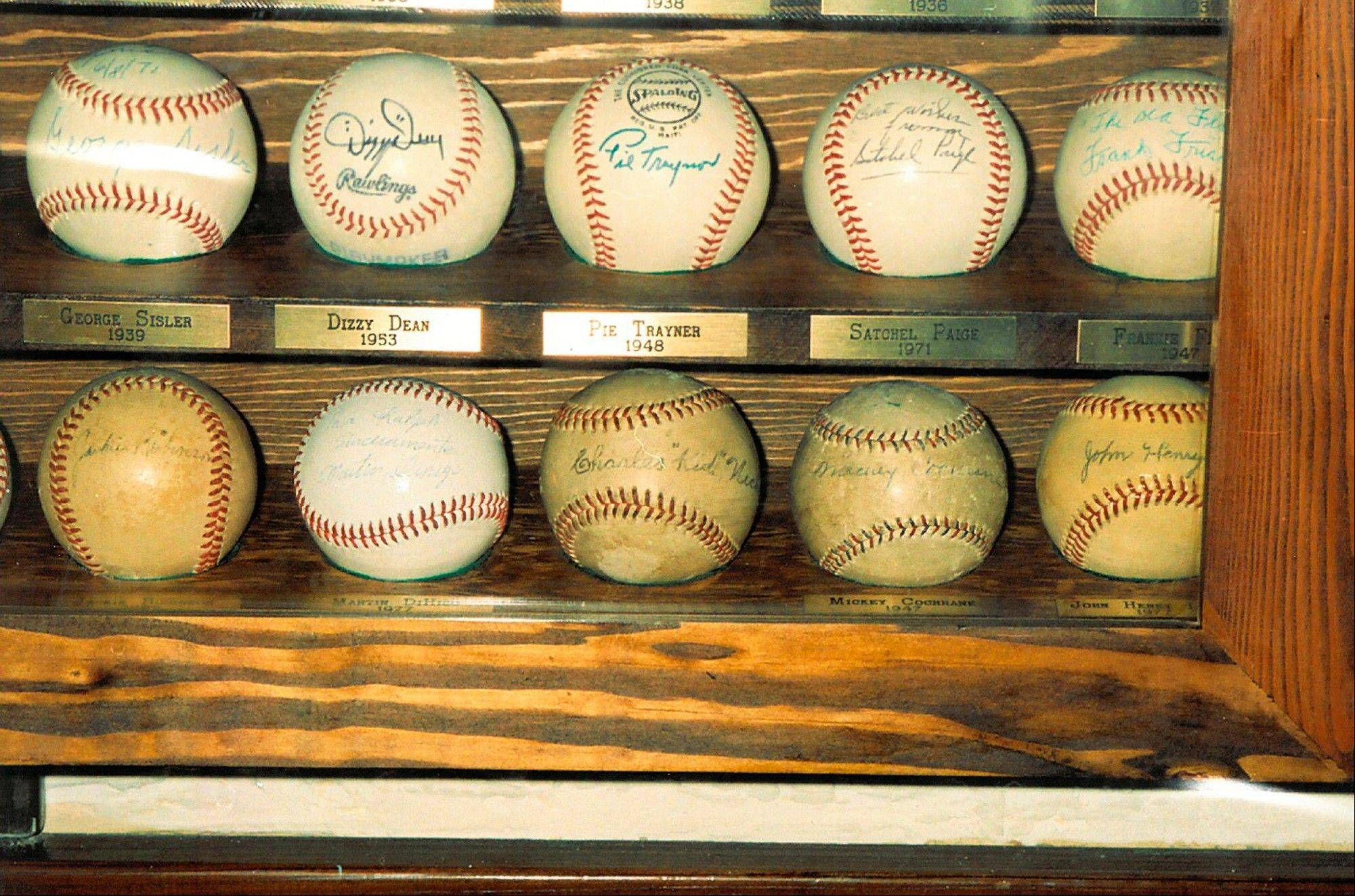 "This 1994 family photo provided by Lyle ""Brad"" Pogofsky via attorney Michael Botti shows part of a collection of autographed baseballs belonging to the late Larry Pogofsky, of Highland, Park, who had spent about 30 years collecting until his death in December. On Thursday, Pogofsky's son, Lyle ""Brad"" Pogofsky appeared in Lake Coounty court, on felony theft and burglary charges that came after the family alerted police he'd made off with some of his late father�s autographed baseballs."