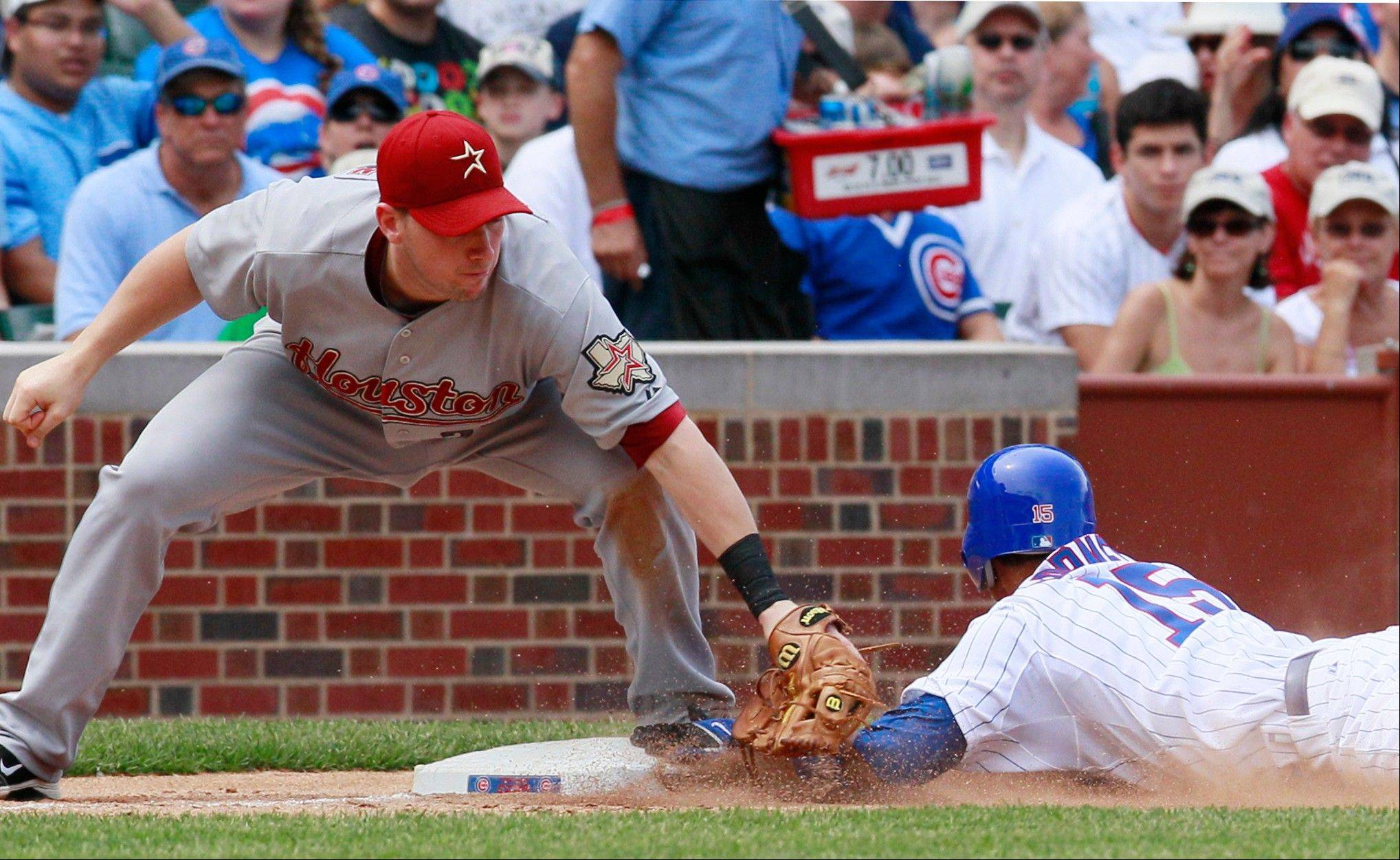 Darwin Barney, right, steals third as Houston's Chris Johnson applies a late tag during the fifth inning of the Cubs' win at Wrigley Field on Friday.