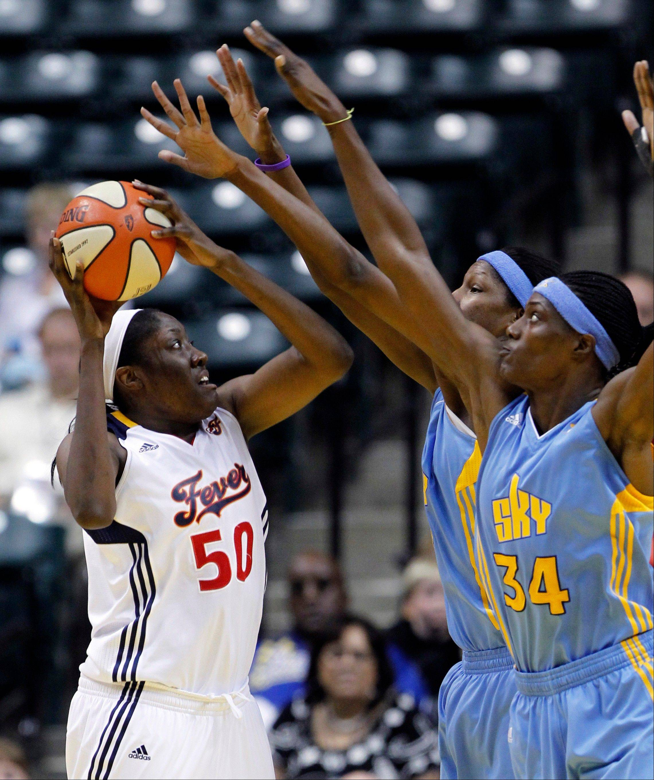 Fever center Jessica Davenport attempts to shoot over Sky defenders Sylvia Fowles (34) and Michelle Snow on Thursday night.