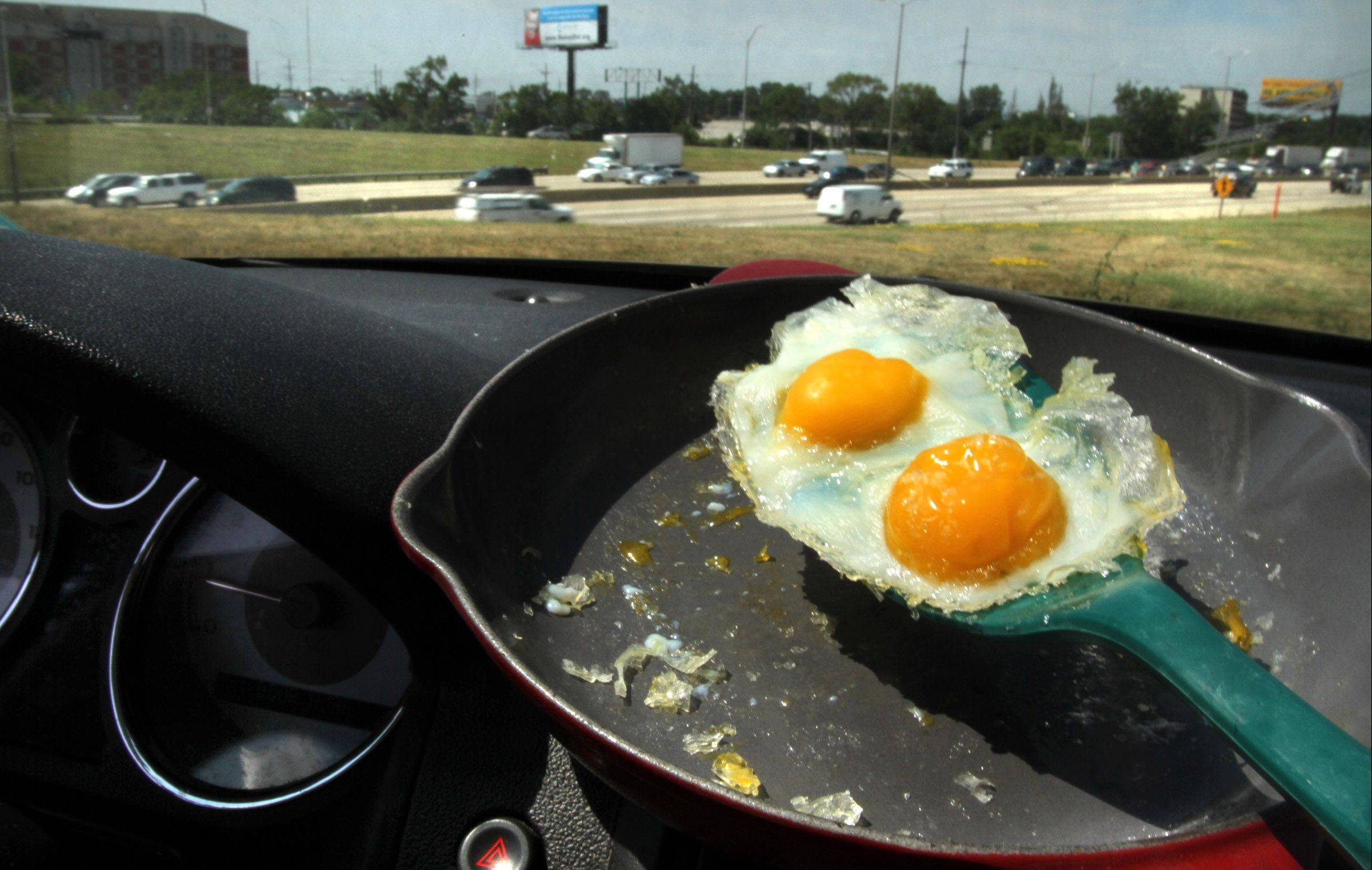 Daily Herald photographer George LeClaire took my ill-fated experiment of more than a decade ago to new heights by successfully frying an egg on the dashboard of his car.