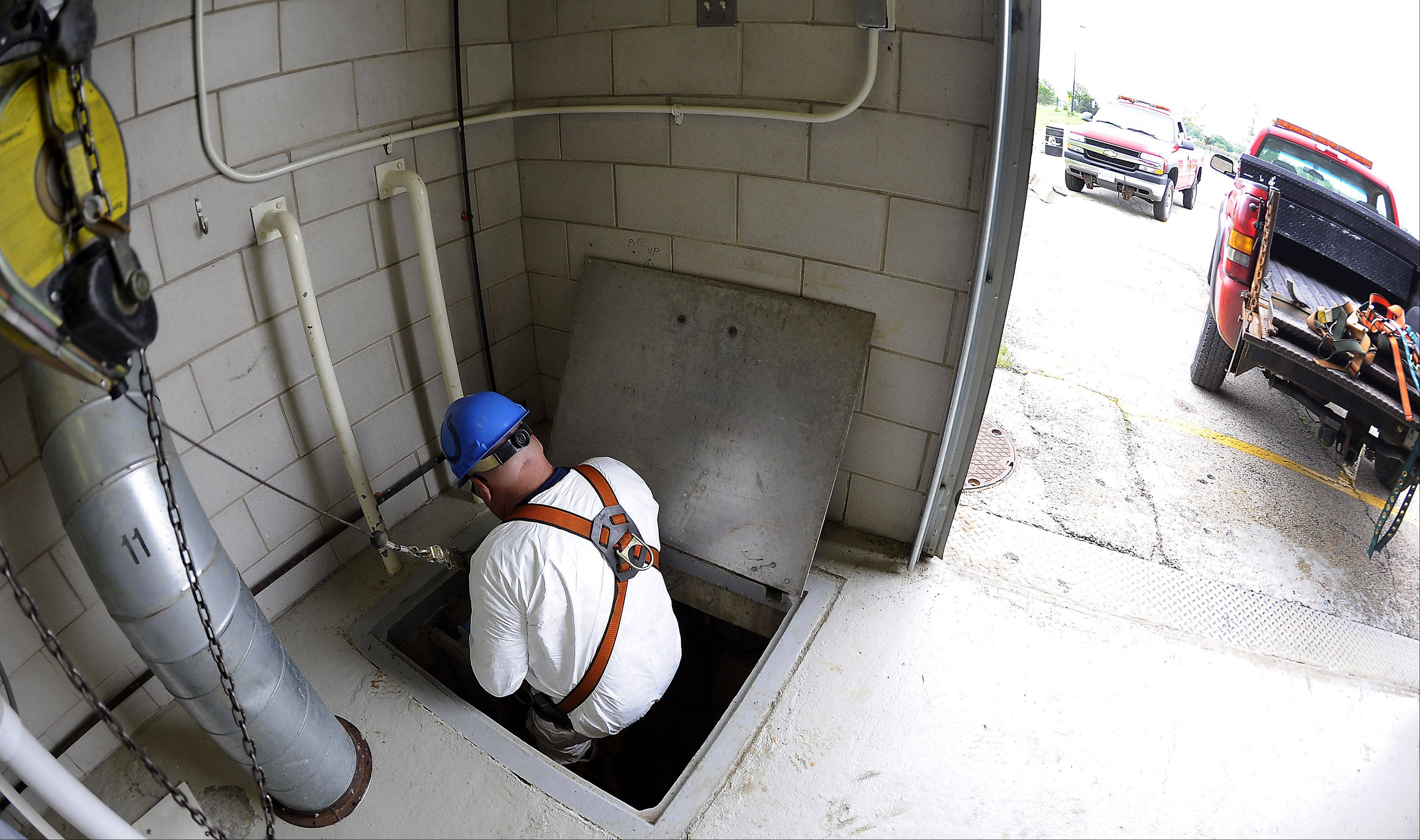 McNamara climbs down almost 40 feet underground into the storm water station.
