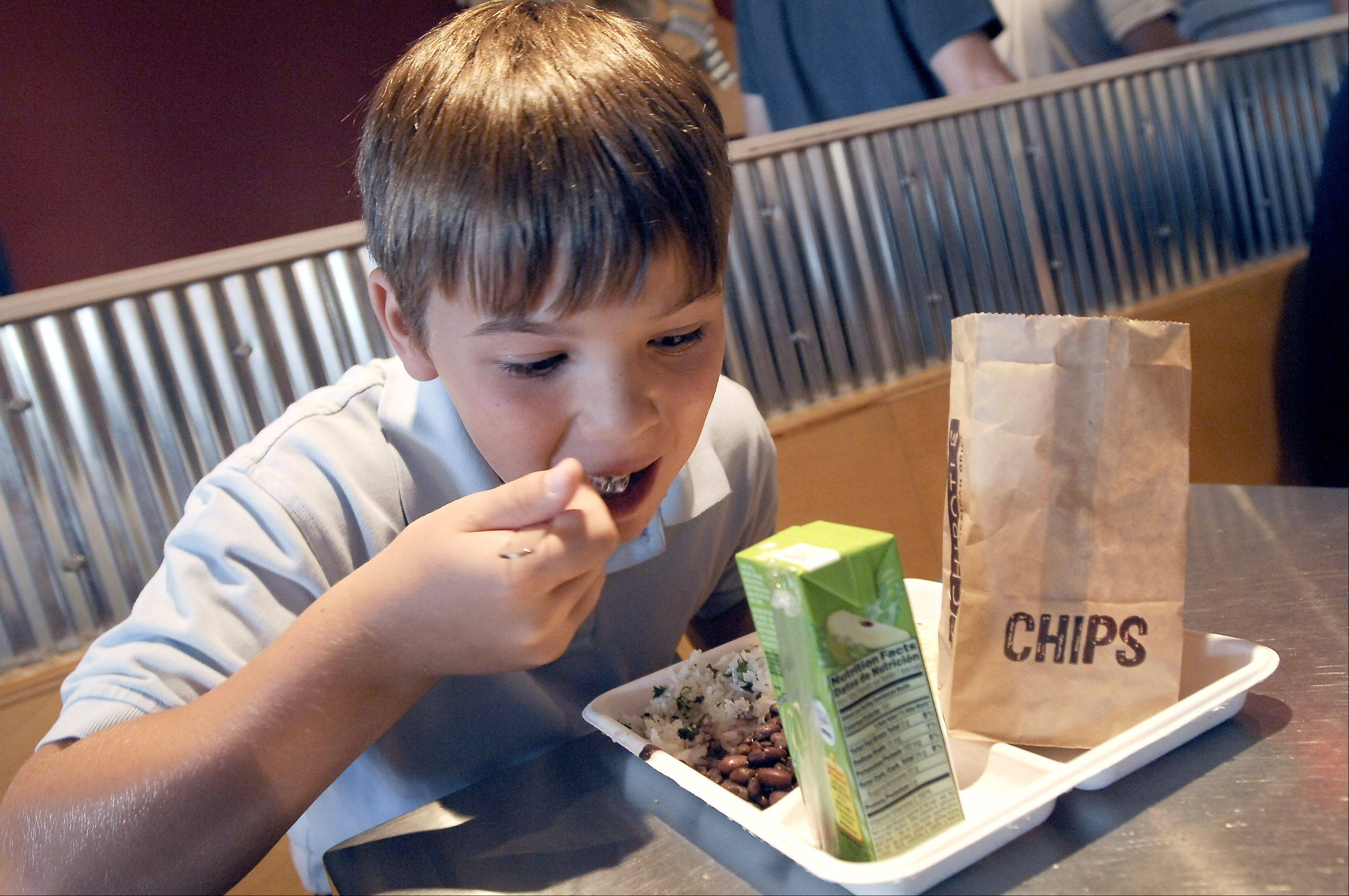 Matt Beiersdorf digs into a quesadilla meal last year at Chipotle Mexican Grill in Arlington Heights. Chipotle is a darling of the stock market because of its profitable business model, rapid growth, and a concept that resonates with customers.