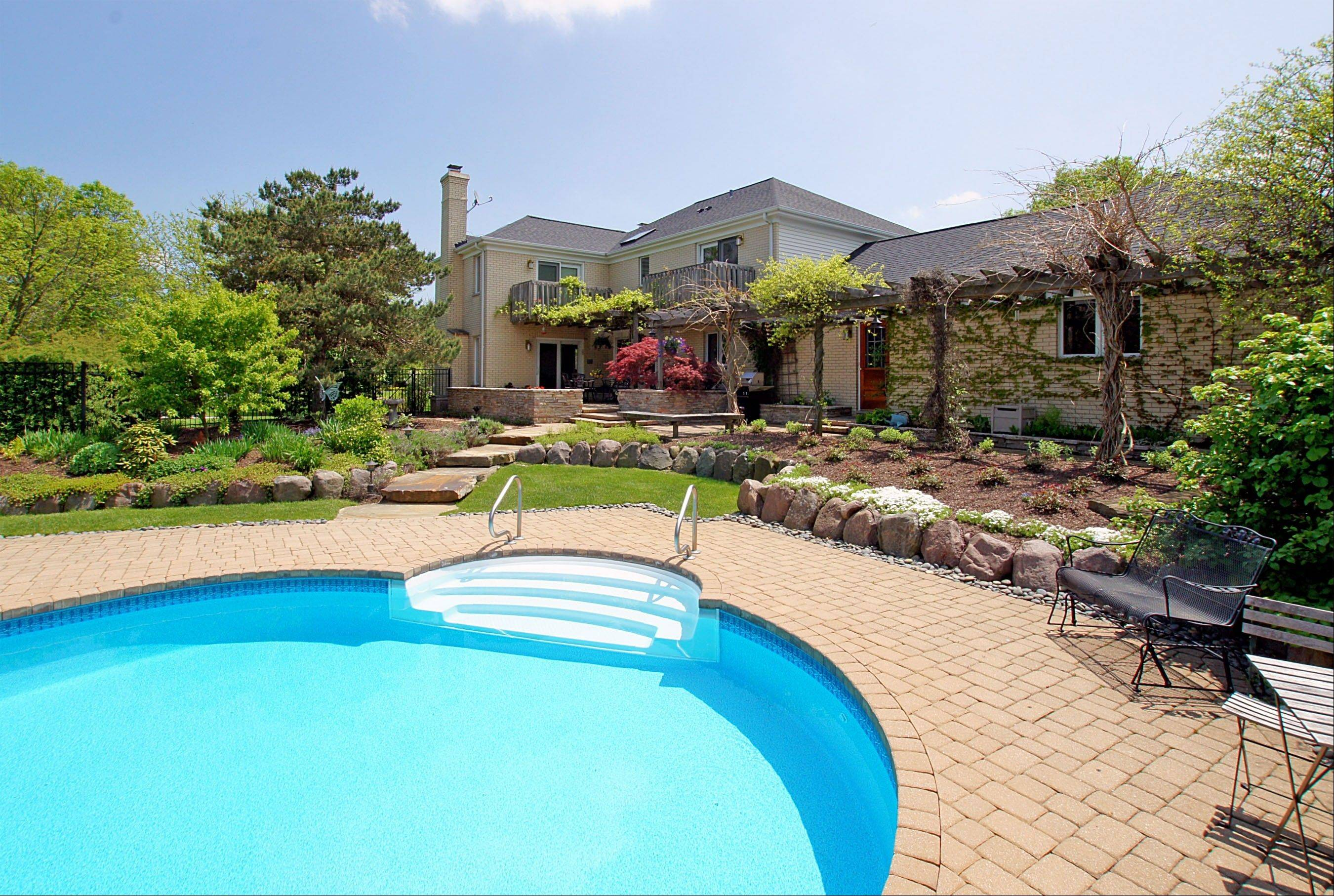 For entertaining or just kicking back, the house has a swimming pool, hot tub and gazebo.